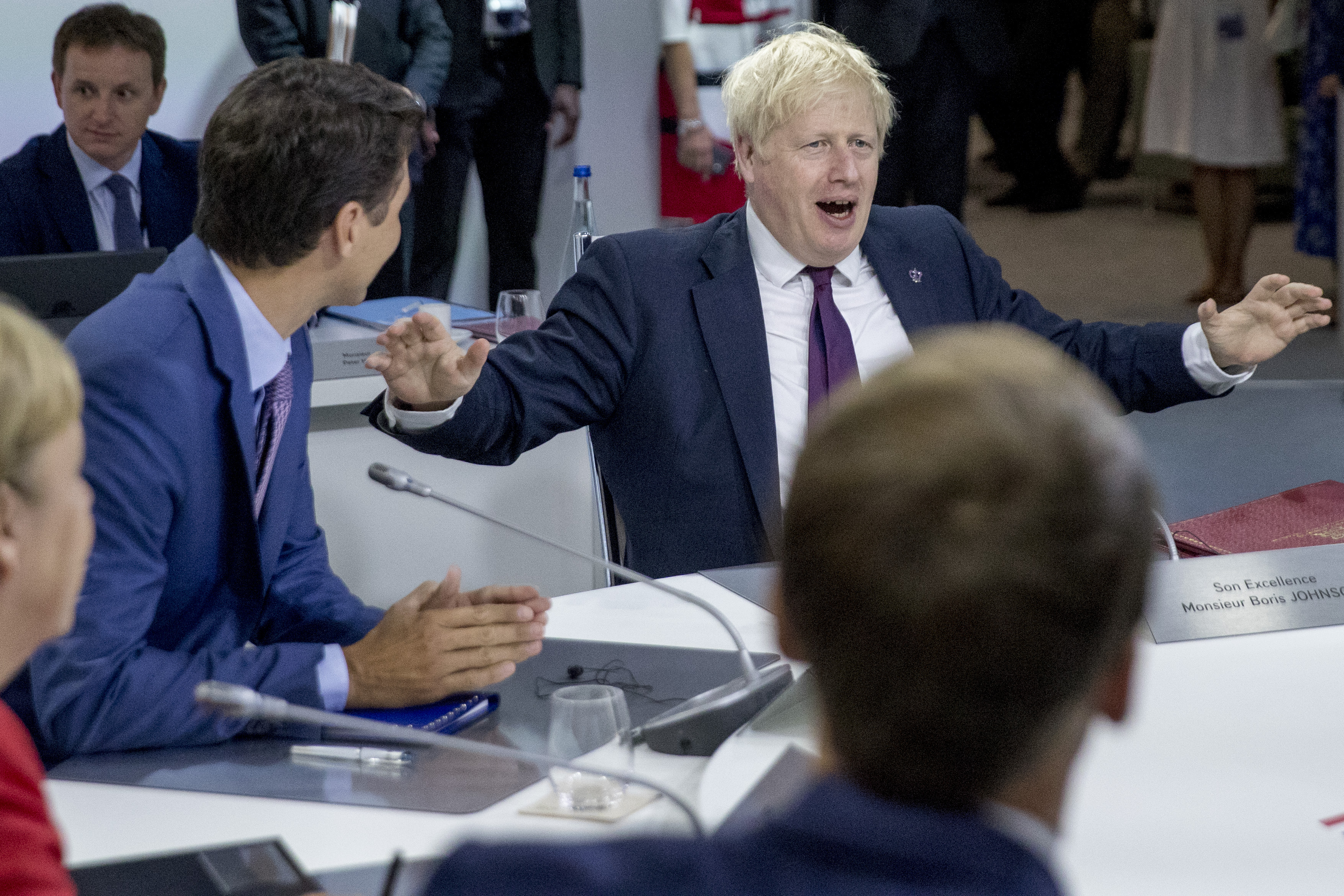 """Britain's Prime Minister Boris Johnson (R) speaks flanked by Canada's Prime Minister Justin Trudeau (L)  during a working session on """"International Economy and Trade, and International Security Agenda"""" in Biarritz, south-west France on August 25, 2019, on the second day of the annual G7 Summit attended by the leaders of the world's seven richest democracies, Britain, Canada, France, Germany, Italy, Japan and the United States. (Photo by Andrew Harnik / POOL / AFP)        (Photo credit should read ANDREW HARNIK/AFP/Getty Images)"""