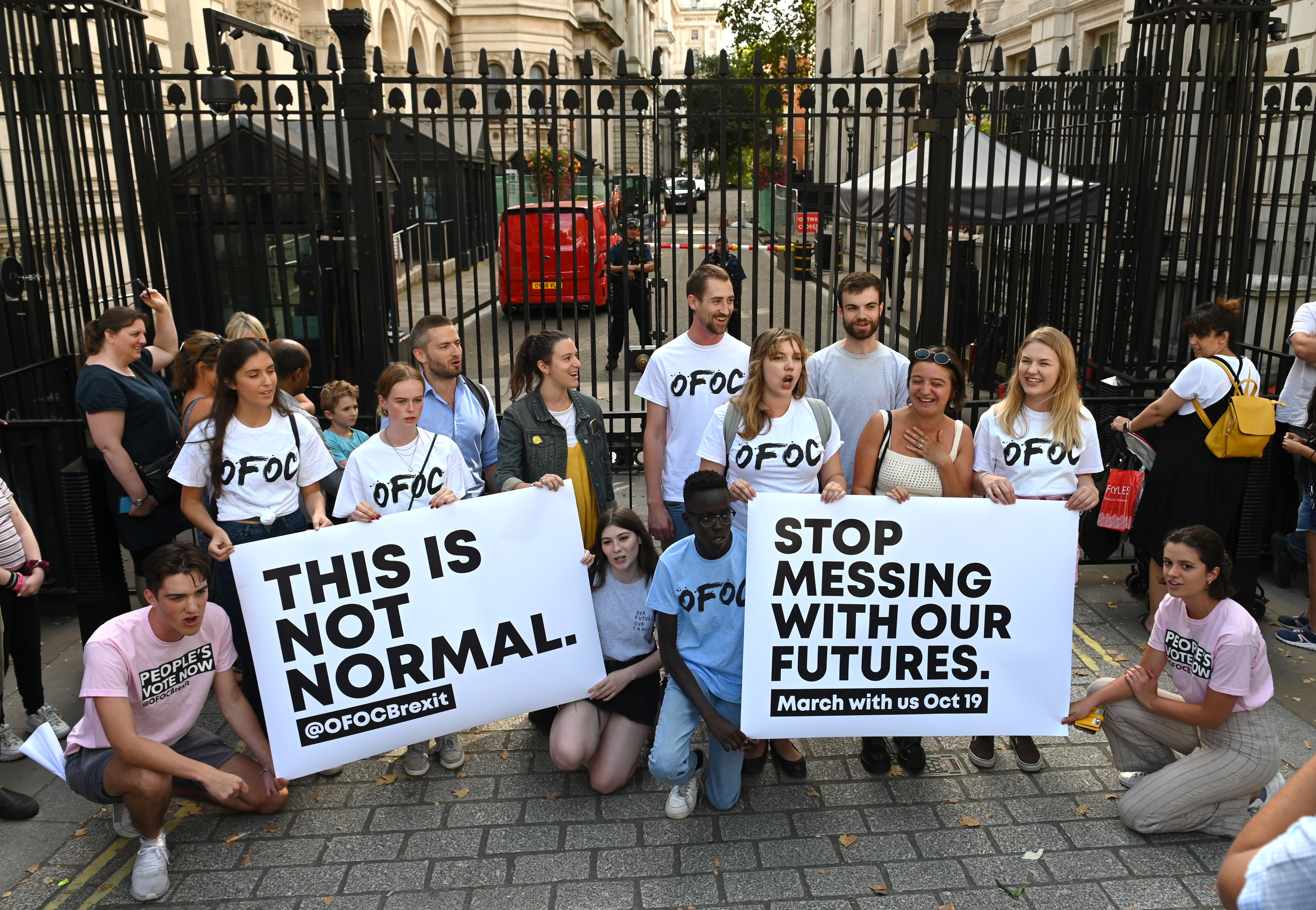 Members of the anti-Briexit Our Future, Our Choice (OFOC) a youth movement supporting a People's Vote on the Brexit deal, demonstrate outside the gates to Downing Street in central London on August 28, 2019. - British Prime Minister Boris Johnson announced Wednesday that the suspension of parliament would be extended until October 14 -- just two weeks before the UK is set to leave the EU -- enraging anti-Brexit MPs. MPs will return to London later than in recent years, giving pro-EU lawmakers less time than expected to thwart Johnson's Brexit plans before Britain is due to leave the European Union on October 31. (Photo by DANIEL LEAL-OLIVAS / AFP)        (Photo credit should read DANIEL LEAL-OLIVAS/AFP/Getty Images)