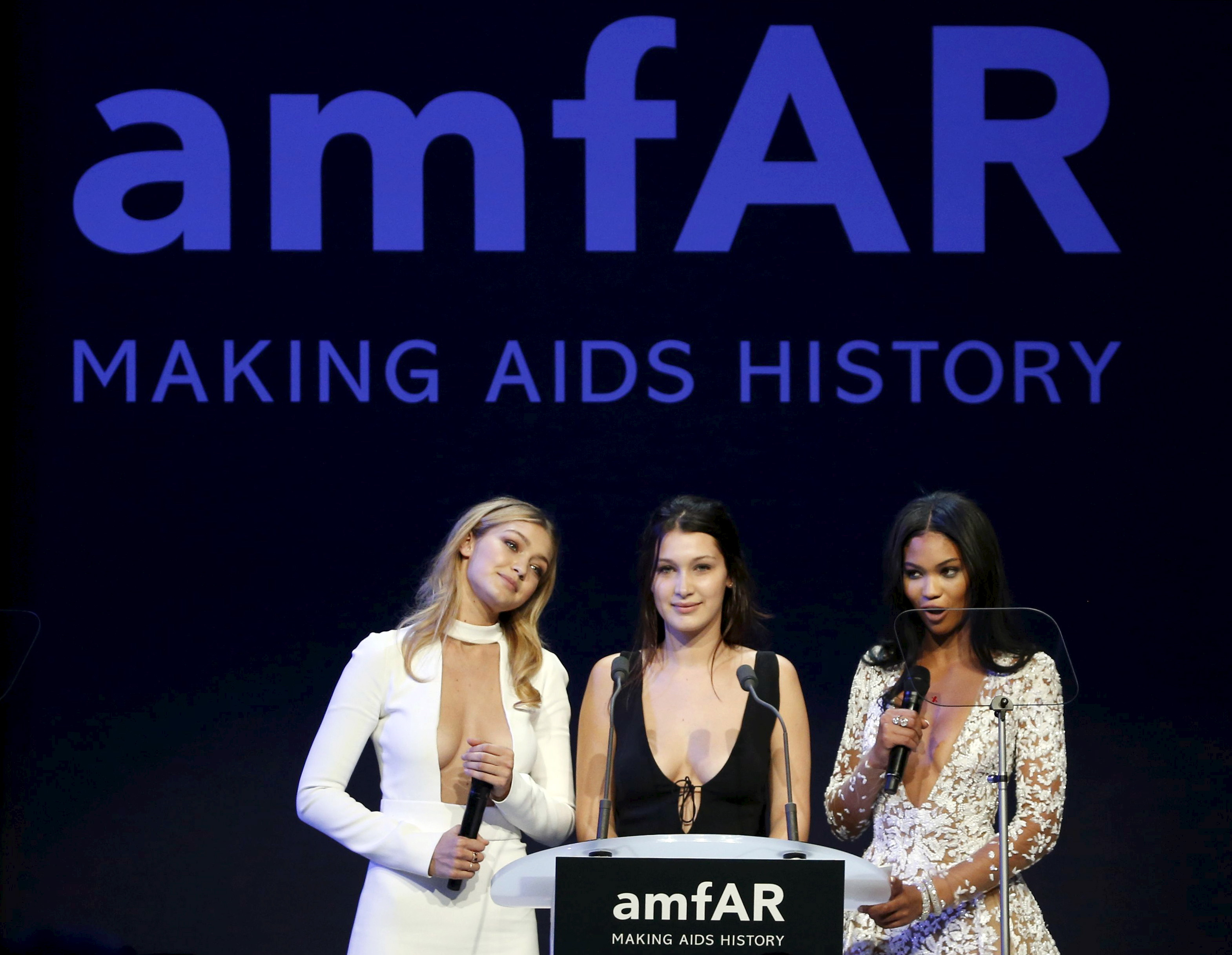 U.S. models Gigi Hadid, Bella Hadid and Chanel Iman conduct the auction during the amfAR's Cinema Against AIDS 2015 event during the 68th Cannes Film Festival in Antibes, near Cannes, southern France, May 21, 2015. REUTERS/ Regis Duvignau