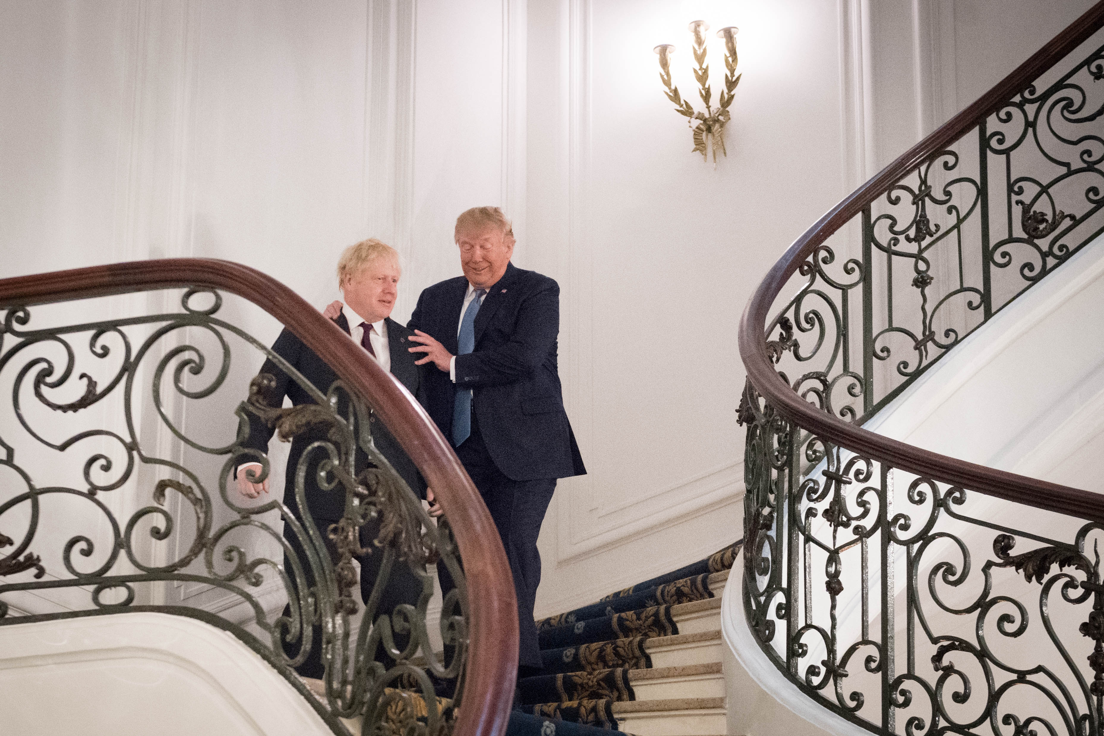 BIARRITZ, FRANCE - AUGUST 25: U.S. President Donald Trump and Britain's Prime Minister Boris Johnson arrive for a bilateral meeting during the G7 summit on August 25, 2019 in Biarritz, France. The French southwestern seaside resort of Biarritz is hosting the 45th G7 summit from August 24 to 26. High on the agenda will be the climate emergency, the US-China trade war, Britain's departure from the EU, and emergency talks on the Amazon wildfire crisis. (Photo by Stefan Rousseau - Pool/Getty Images)