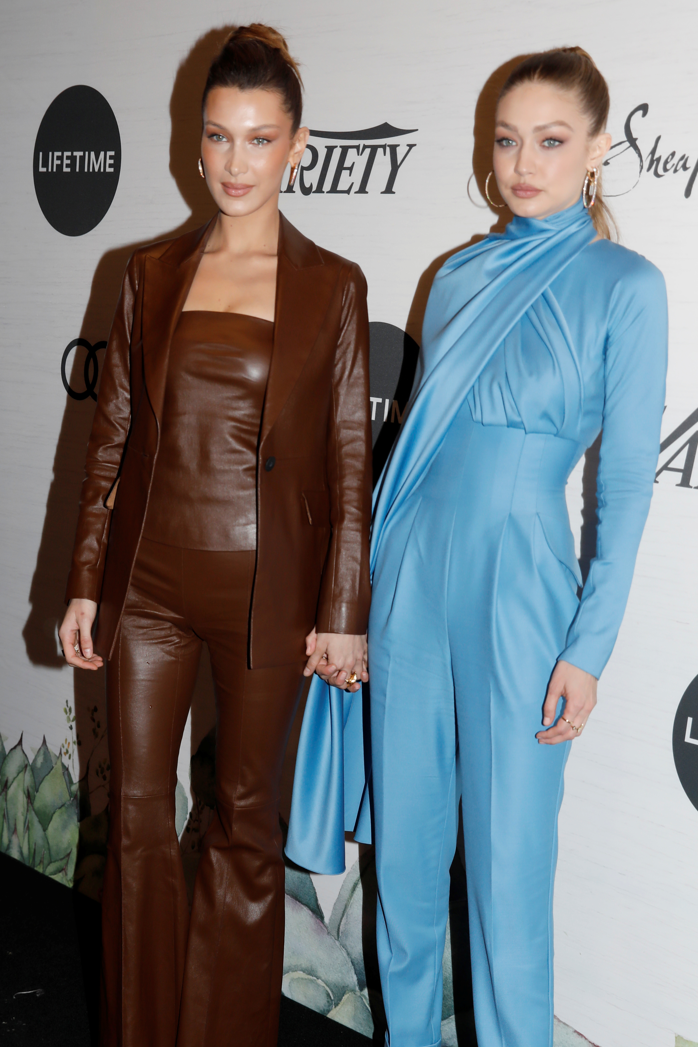 Gigi Hadid and her sister Bella pose on the red carpet at the 2019 Variety's Power of Women event in New York, U.S., April 5, 2019. REUTERS/Shannon Stapleton