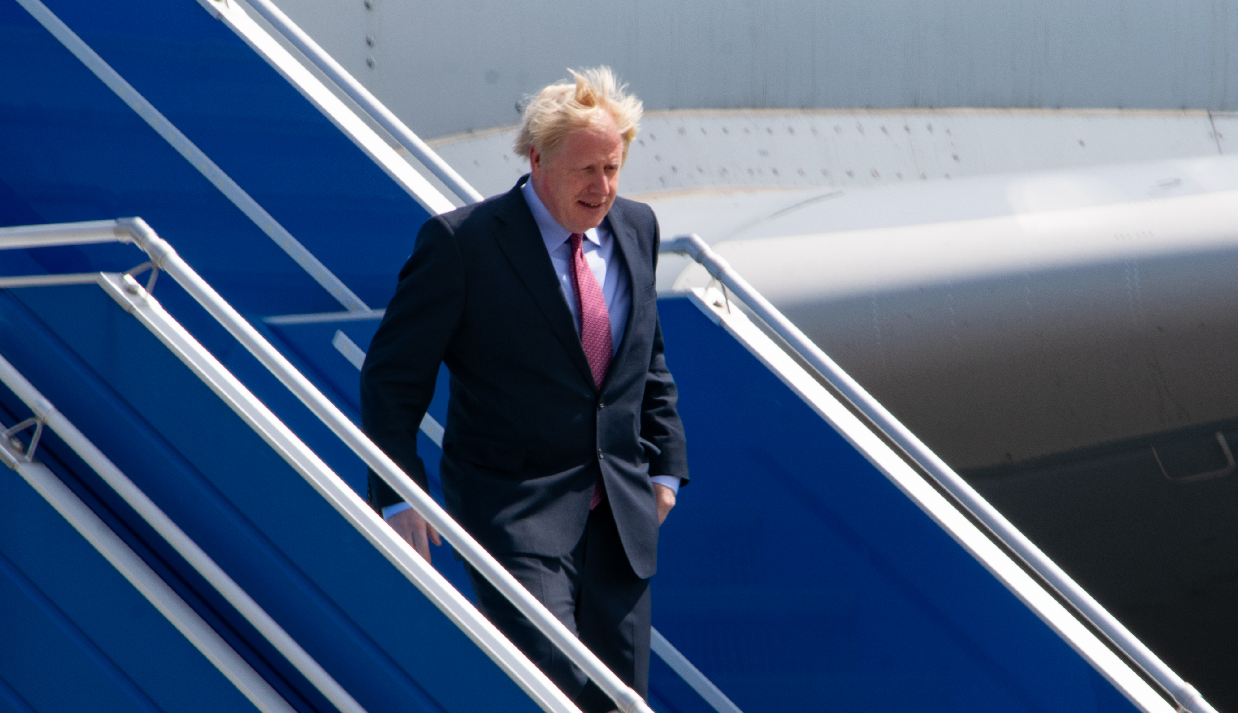 British Prime Minister Boris Johnson disembarks a plane as he arrives as Biarritz Pays Basque Airport for the G7 summit on August 24, 2019 in Biarritz, France. The French southwestern seaside resort of Biarritz is hosting the 45th G7 summit from August 24 to 26. High on the agenda will be the climate emergency, the US-China trade war, Britain's departure from the EU, and emergency talks on the Amazon wildfire crisis.(Photo by Adrià Salido Zarco/NurPhoto via Getty Images)