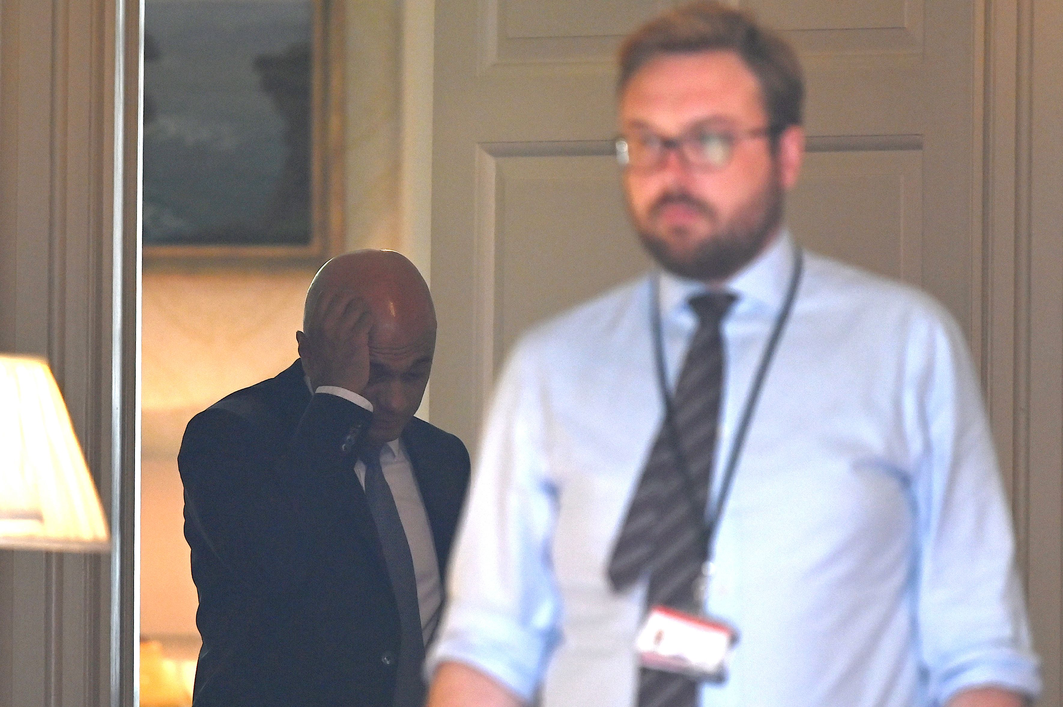 A picture taken from the street looking through the open door of 11 Downing Street in central London on August 28, 2019 shows Britain's Chancellor of the Exchequer Sajid Javid (L) inside 11 Downing Street. - British Prime Minister Boris Johnson announced Wednesday that the suspension of parliament would be extended until October 14 -- just two weeks before the UK is set to leave the EU -- enraging anti-Brexit MPs. (Photo by DANIEL LEAL-OLIVAS / AFP)        (Photo credit should read DANIEL LEAL-OLIVAS/AFP/Getty Images)