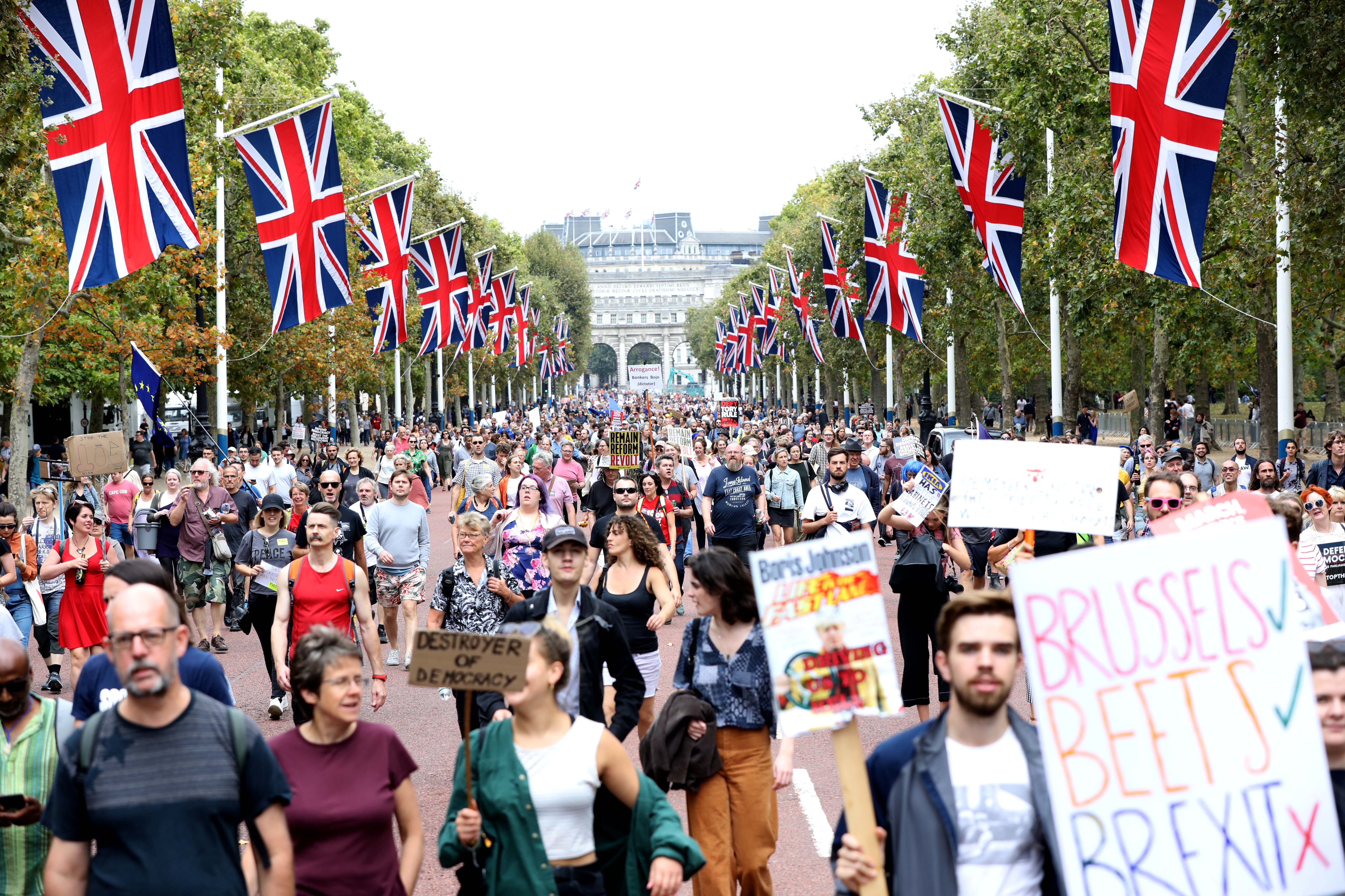 Protesters taking part in the 'Let Us Vote' day of action, organised by Another Europe is Possible campaign group in central London to demonstrate against Prime Minister Boris Johnson's decision to suspend Parliament for up to five weeks before a Queen's Speech on October 14. (Photo by Rick Findler/PA Images via Getty Images)