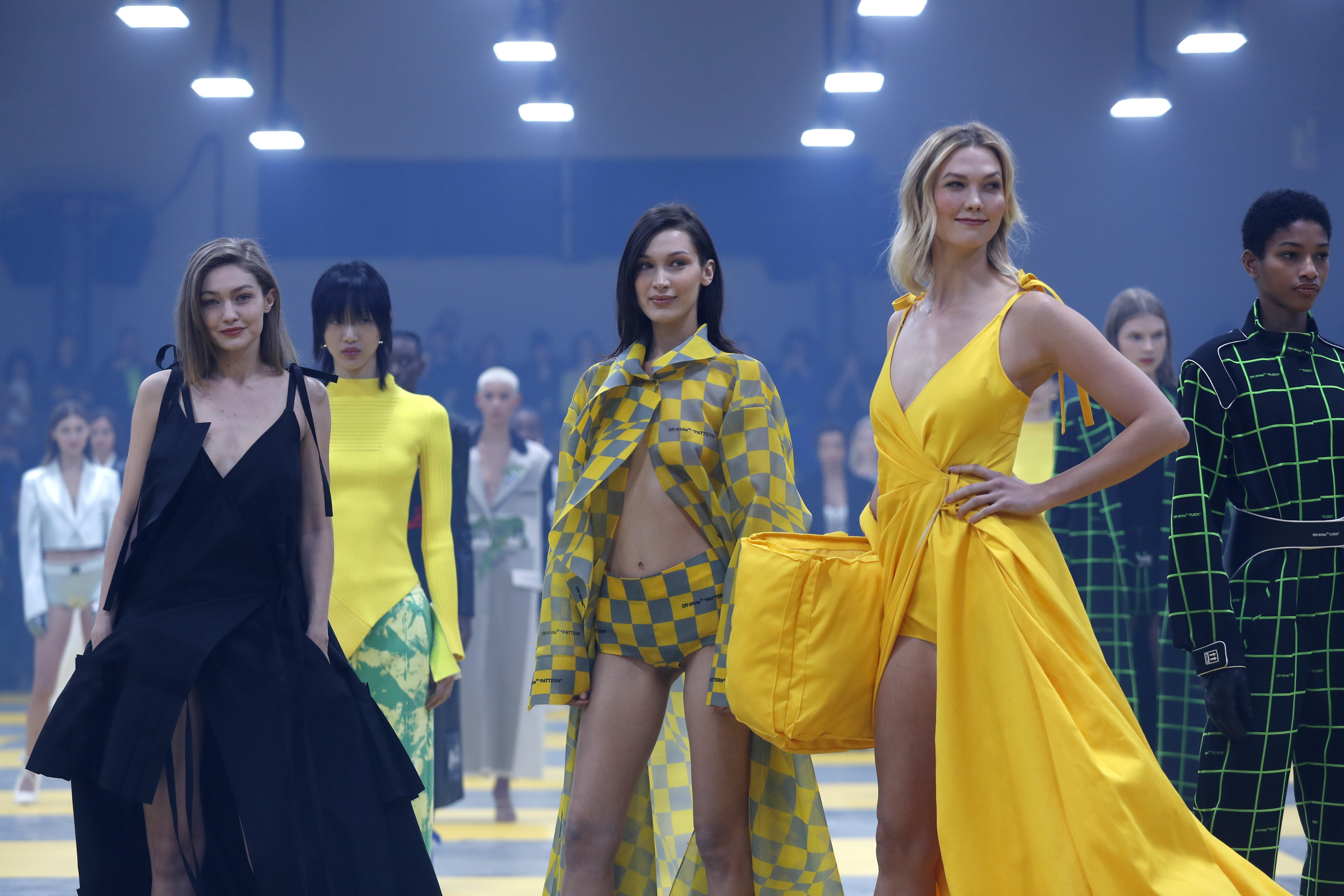 Models Gigi Hadid, from left, Bella Hadid and Karlie Kloss wear creations as part of the Off-White ready to wear Fall-Winter 2019-2020 collection, that was presented in Paris, Thursday, Feb. 28, 2019. (AP Photo/Thibault Camus)