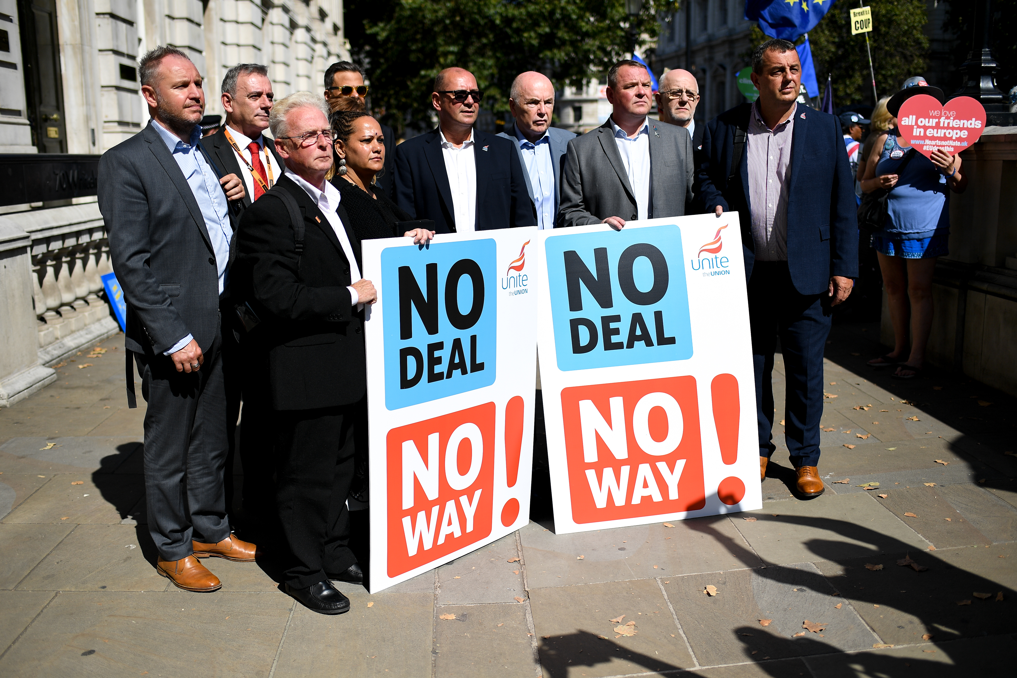 British Steel union representatives show placards as Demonstrators gather outside Cabinet Office waving Union and EU flags to protest against the Parliament suspension, Central London on August 29, 2019. Parliament will be suspended just days after MPs return to work in September - and only a few weeks before the Brexit deadline. (Photo by Alberto Pezzali/NurPhoto via Getty Images)