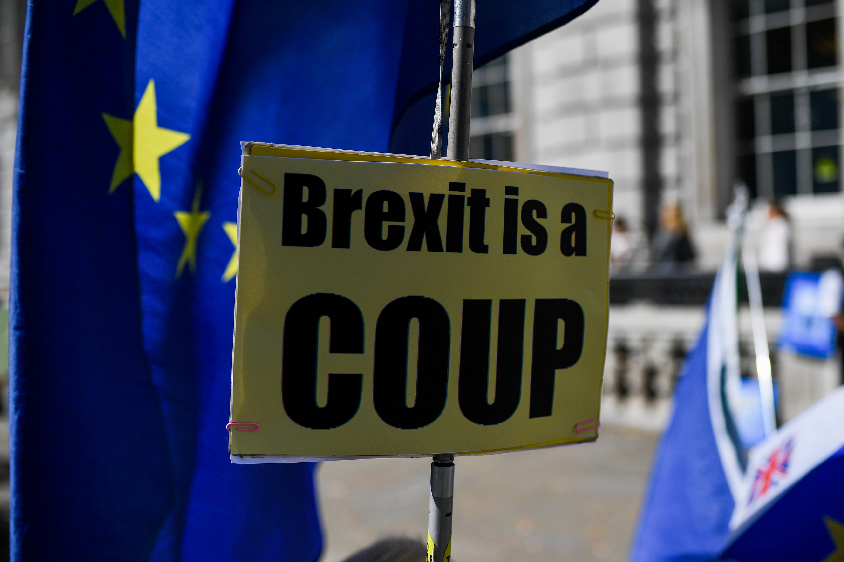Demonstrators gather outside Cabinet Office waving Union and EU flags to protest against the Parliament suspension, Central London on August 29, 2019. Parliament will be suspended just days after MPs return to work in September - and only a few weeks before the Brexit deadline. (Photo by Alberto Pezzali/NurPhoto via Getty Images)