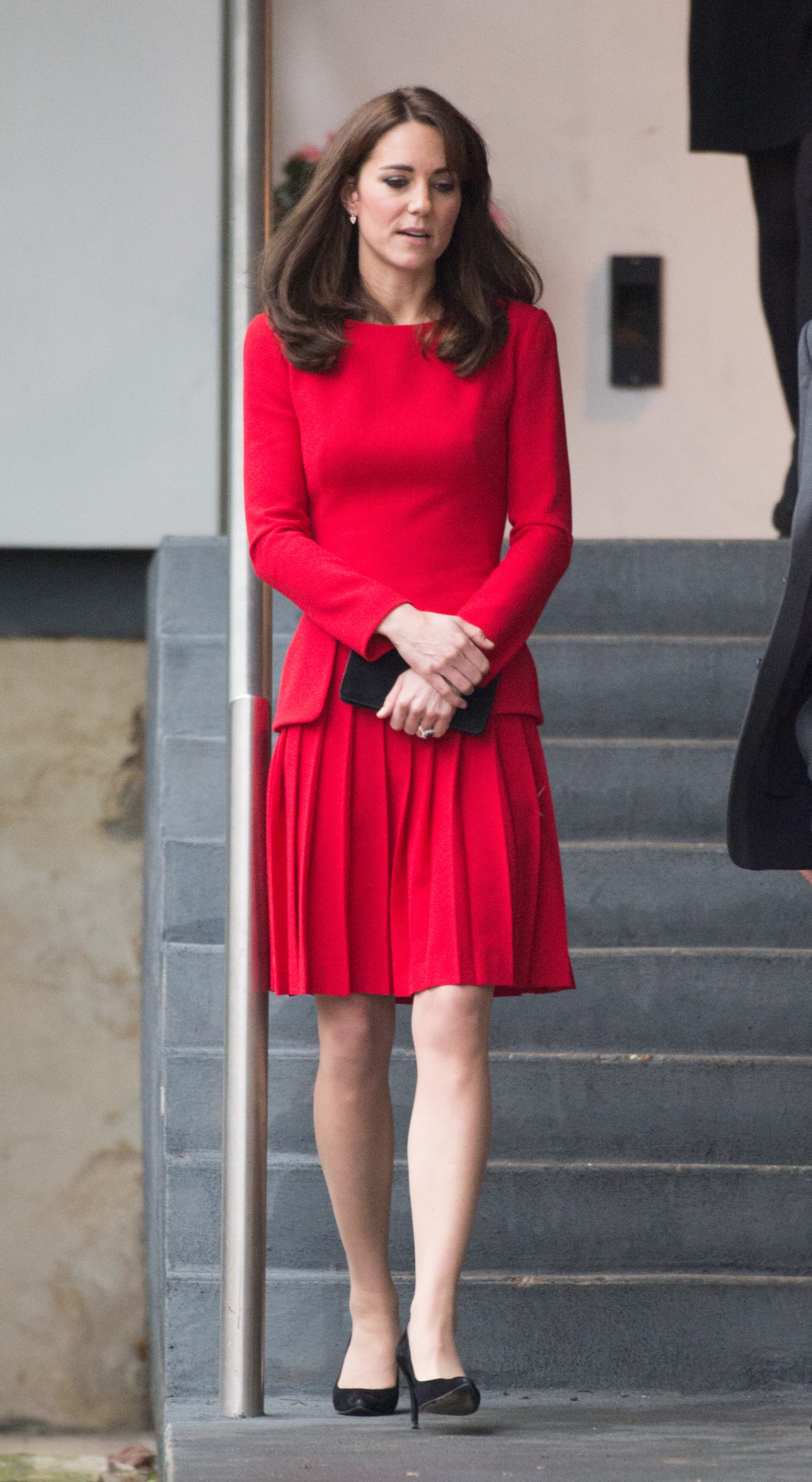 Catherine, Duchess of Cambridge, wearing a red Alexander McQueen dress, visits The Anna Freud Centre in London (Photo by Zak Hussein/Corbis via Getty Images)