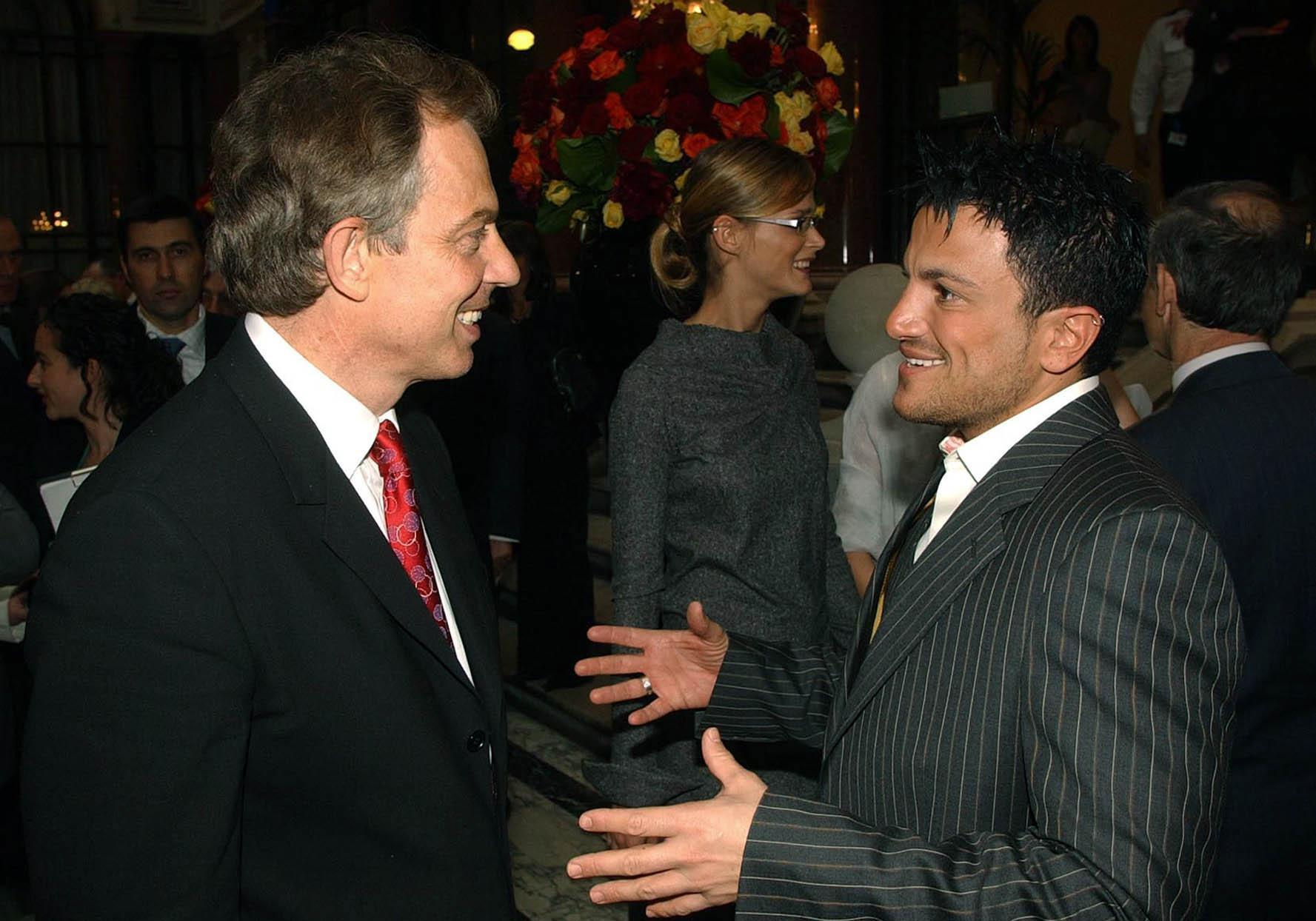 British Prime Minister Tony Blair talks to singer Peter Andre  during the EU enlargement: Unification of Europe - VIP Party, to celebrate the entry of 10 new countries into the European Union, at the Foreign and Commonwealth Office in London.  Where Mr Blair launched the Crossroads for Ideas initiative, a joint project between the Foreign Office and the British Council.   The scheme will bring some of the most talented young professionals from Central Europe - working in television, fashion, design, architecture, science, the environment and finance - to meet their British counterparts to exchange ideas, experiences and skills.