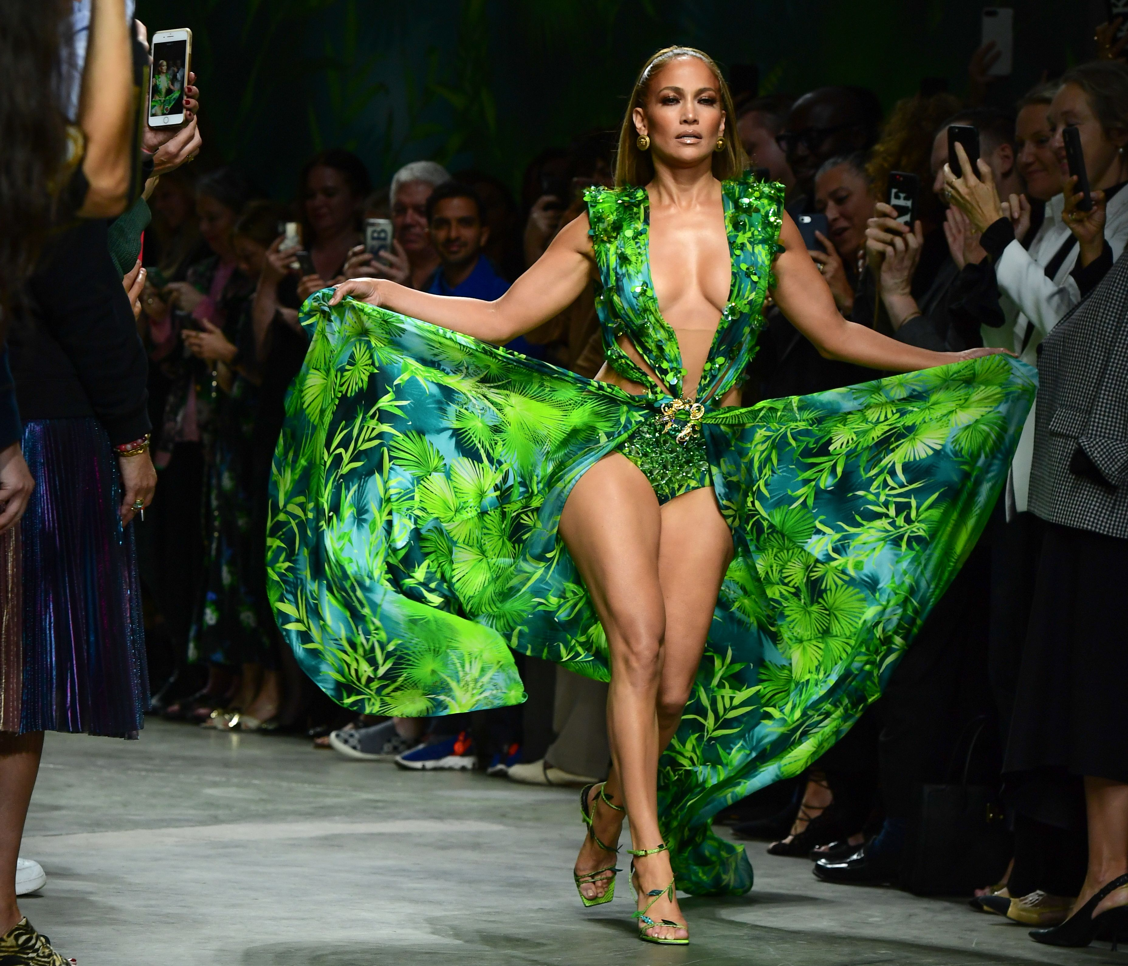US singer Jennifer Lopez presents a creation for Versace's Women's Spring Summer 2020 collection in Milan on September 20, 2019. (Photo by Miguel MEDINA / AFP)        (Photo credit should read MIGUEL MEDINA/AFP/Getty Images)