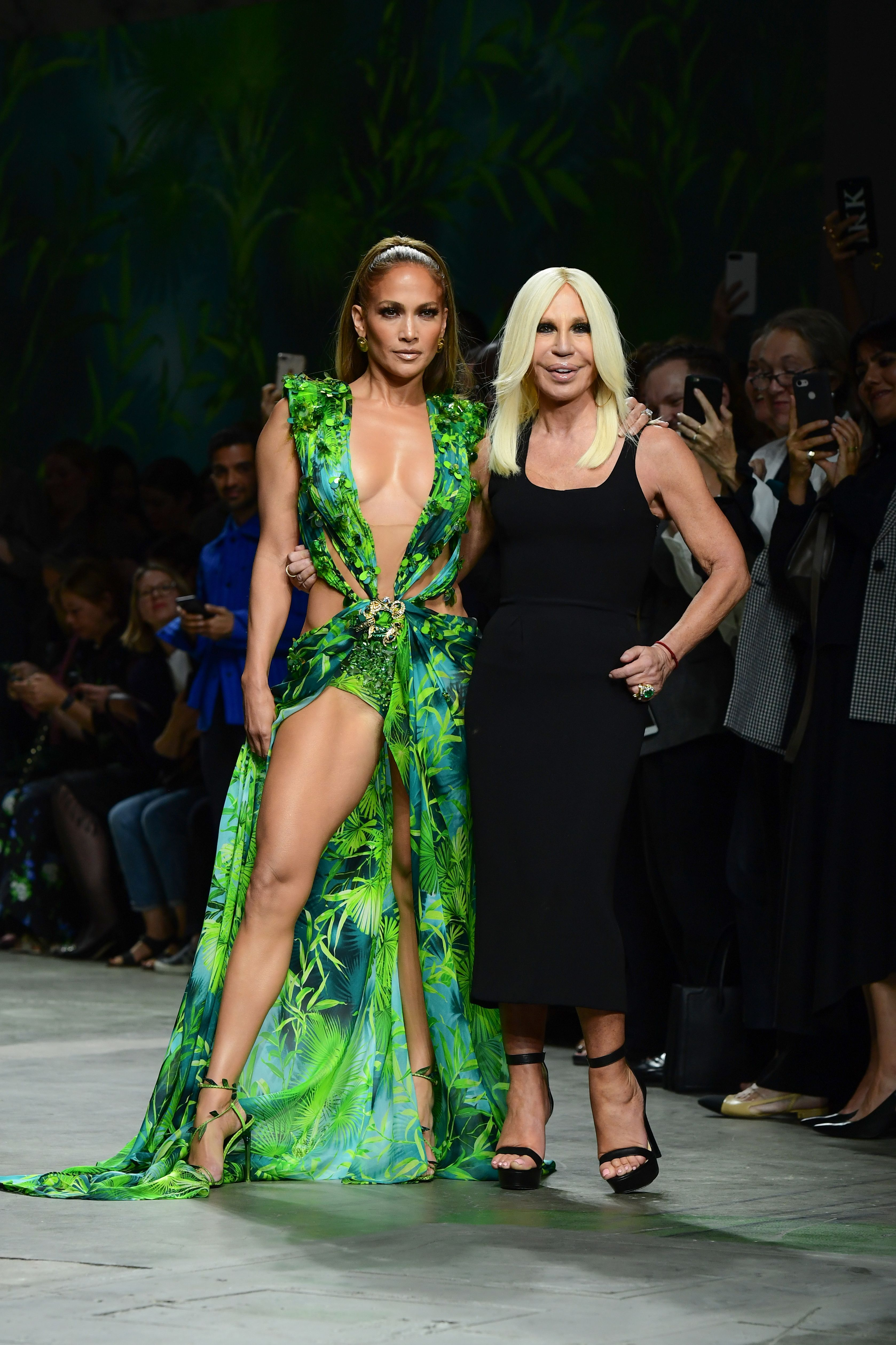 Italian fashion designer Donatella Versace (R) and US singer Jennifer Lopez pose following the presentation of Versace's Women's Spring Summer 2020 collection in Milan on September 20, 2019. (Photo by Miguel MEDINA / AFP)        (Photo credit should read MIGUEL MEDINA/AFP/Getty Images)