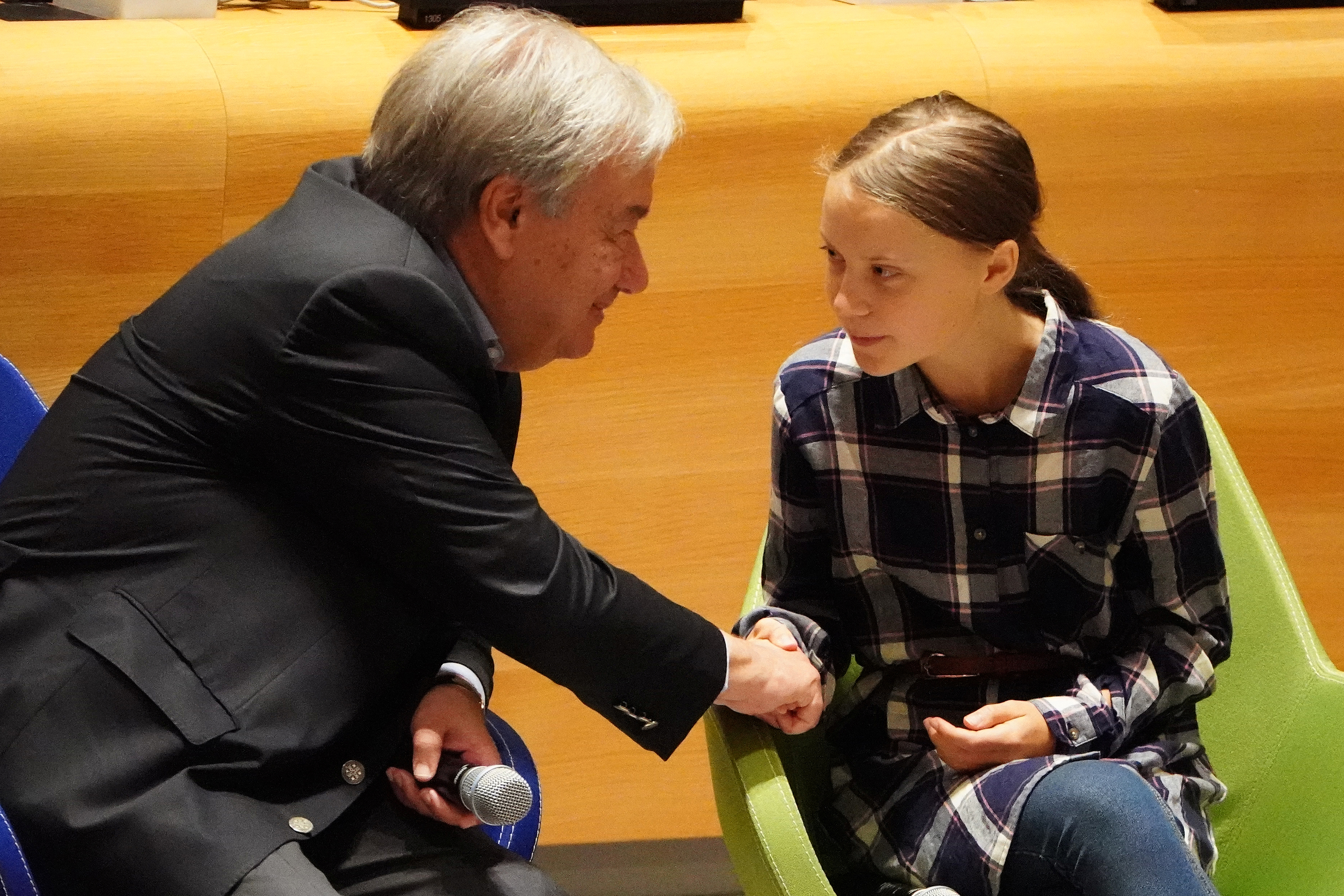 Secretary-General of the United Nations Antonio Guterres shakes hands with Swedish environmental activist Greta Thunberg at the Youth Climate Summit at United Nations Headquarters in the Manhattan borough of New York, New York, U.S., September 21, 2019. REUTERS/Carlo Allegri