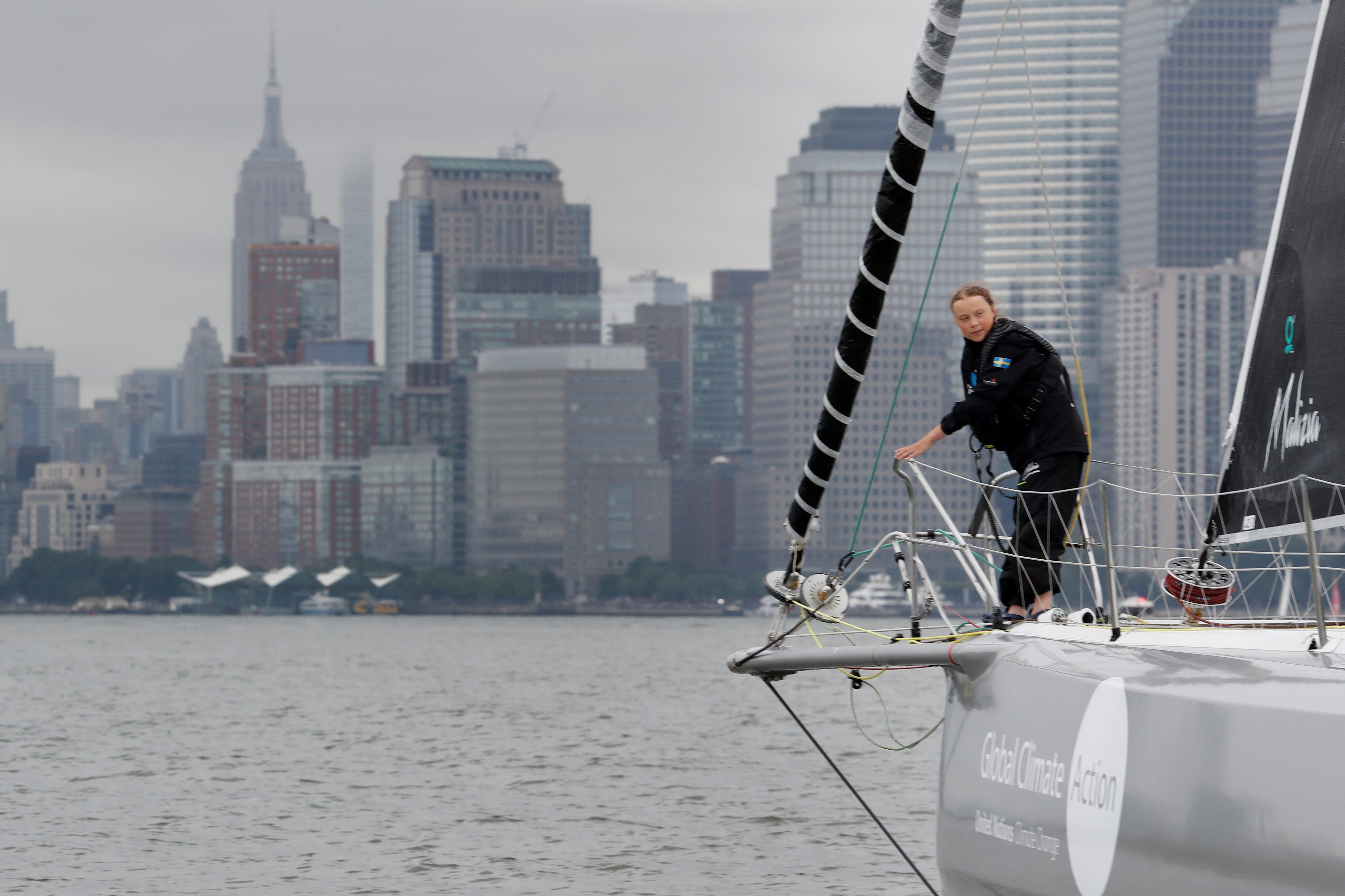 Swedish 16-year-old activist Greta Thunberg sails on the Malizia II racing yacht in New York Harbor as she nears the completion of her trans-Atlantic crossing in order to attend a United Nations summit on climate change in New York, U.S., August 28, 2019. REUTERS/Mike Segar     TPX IMAGES OF THE DAY