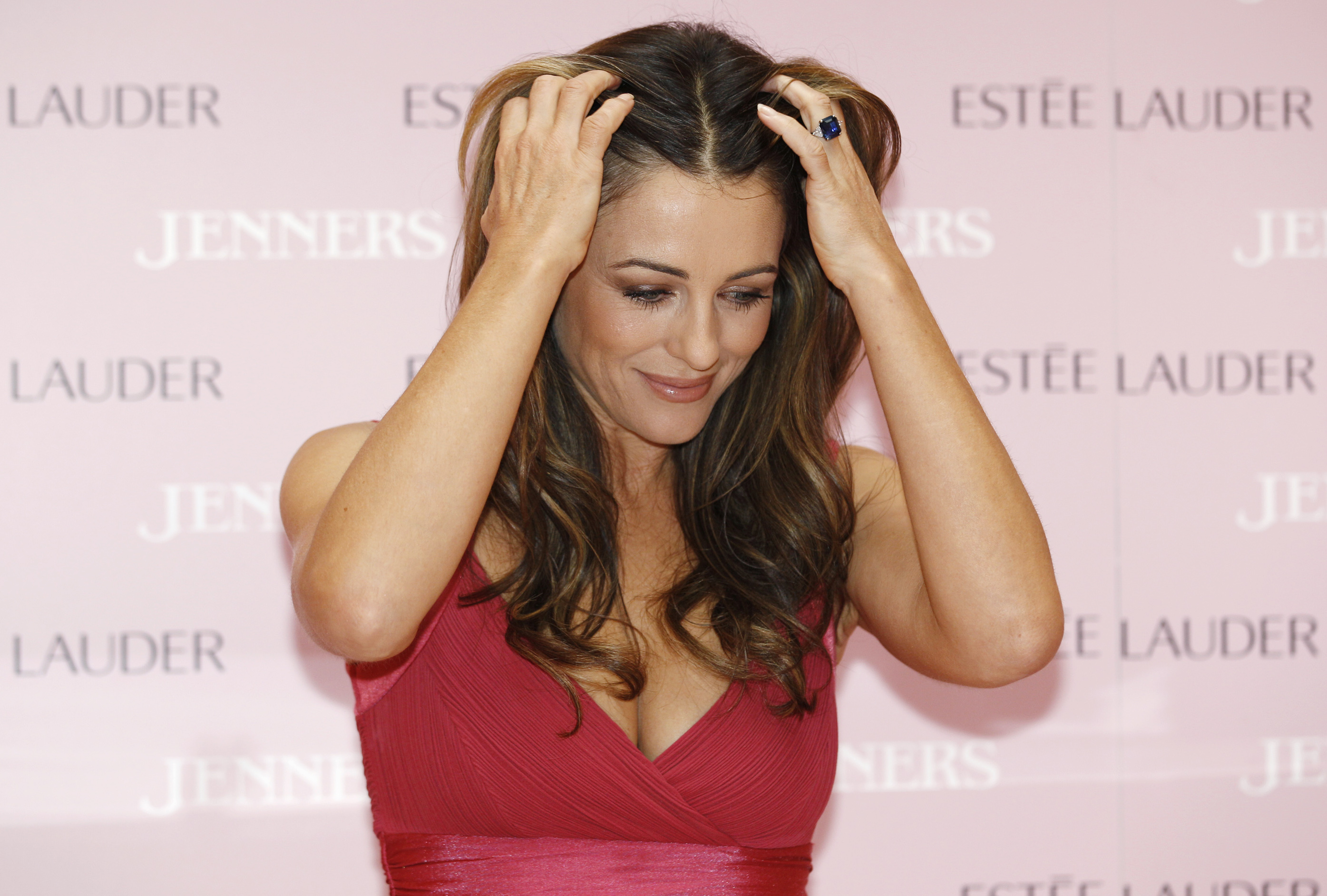 Actress and model Liz Hurley wears her engagement ring as she attends a breast cancer awareness launch at a department store in Edinburgh, Scotland October 4, 2011. REUTERS/David Moir (BRITAIN - Tags: ENTERTAINMENT HEALTH PROFILE)