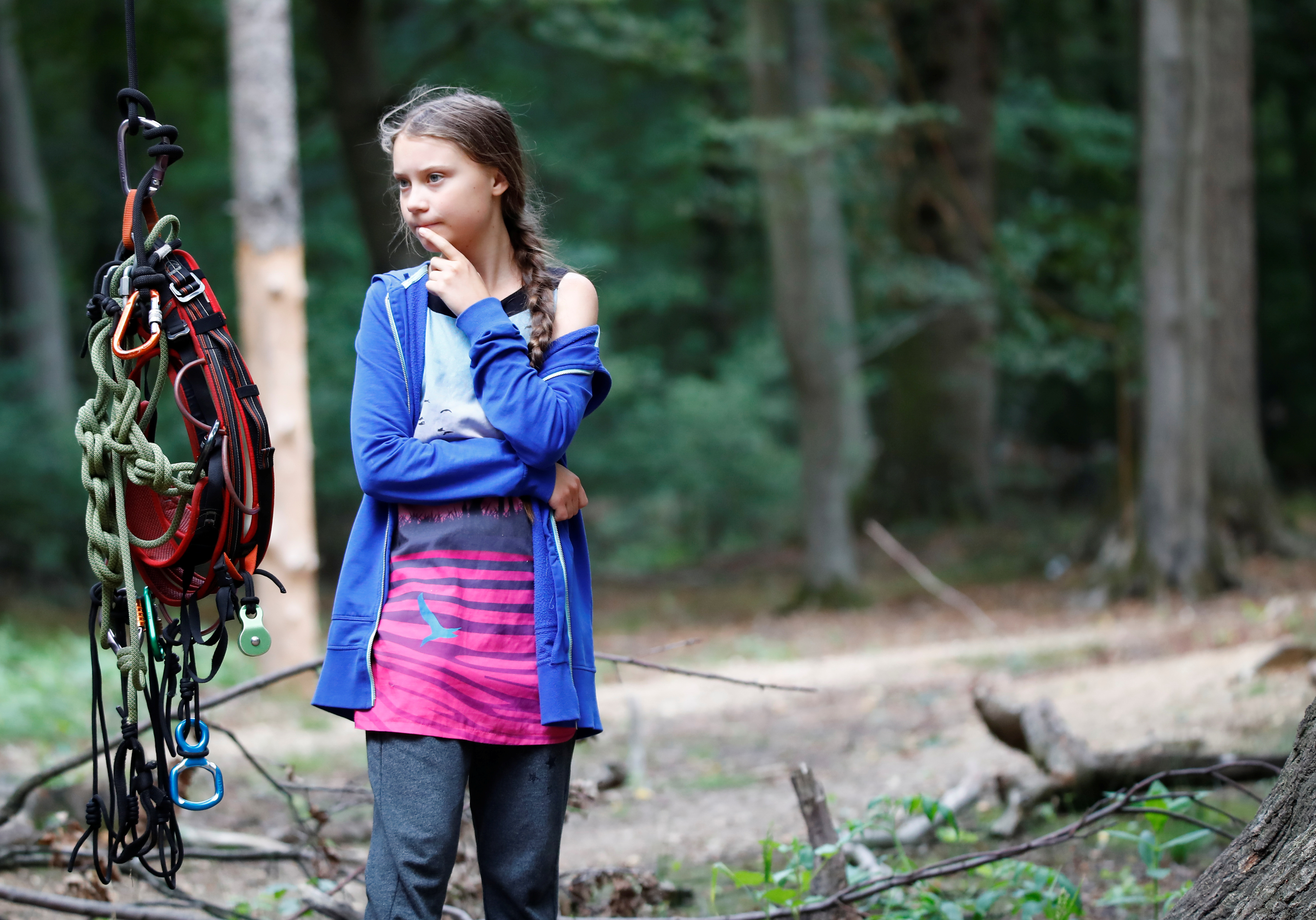 """Greta Thunberg, Swedish """"Fridays for Future"""" climate activist, stands next to climbing equipment that hangs from an illegal tree house in the Hambach Forest that is supposed to be chopped away for the nearby open-cast brown coal mine of German utility RWE, west of Cologne, Germany, August 10, 2019. REUTERS/Wolfgang Rattay"""