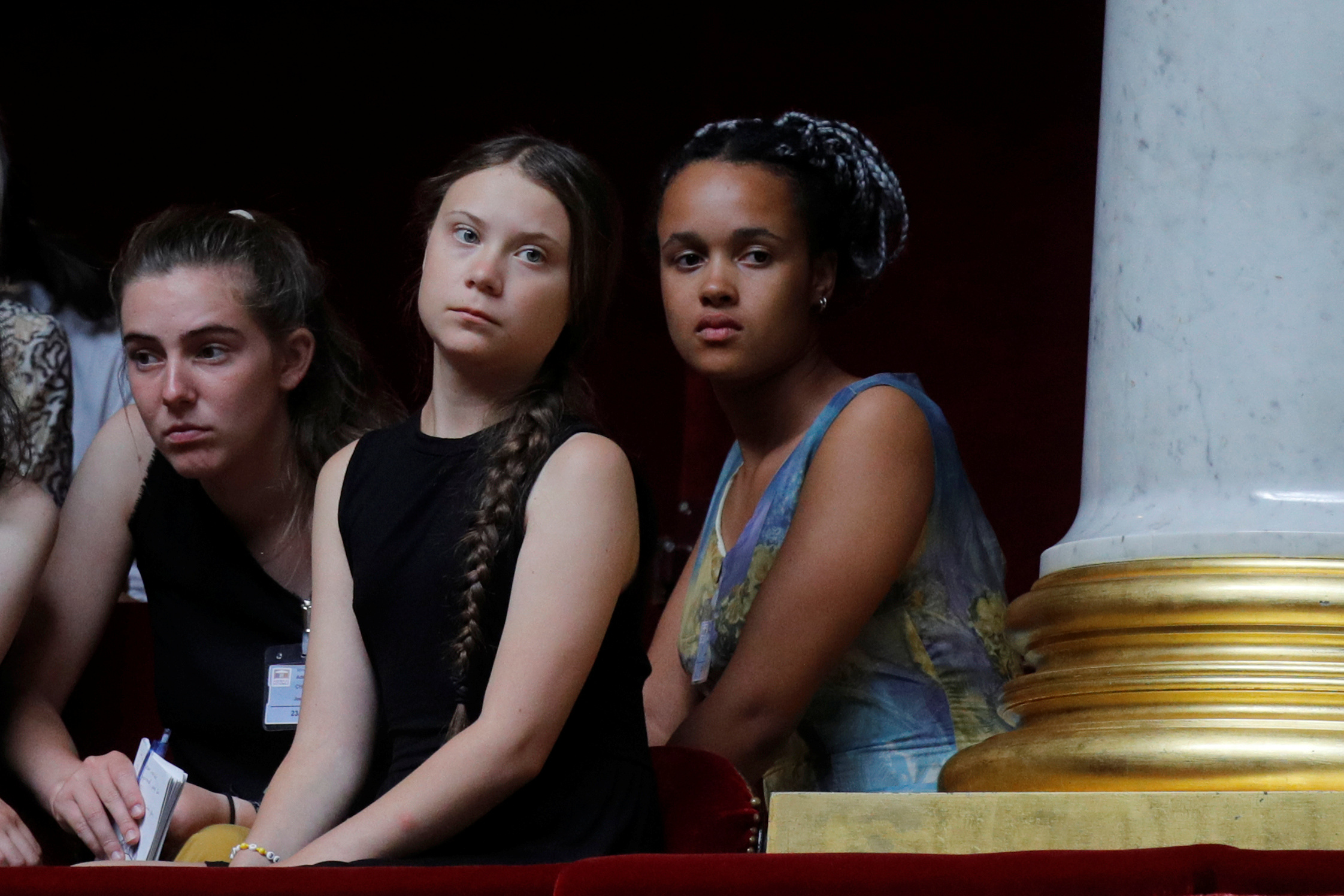 Swedish environmental activist Greta Thunberg, Adelaide Charlier and Alicia Arquetoux, French activists from the Youth for Climate movement, attend the questions to the government session at the National Assembly in Paris, France, July 23, 2019.  REUTERS/Philippe Wojazer