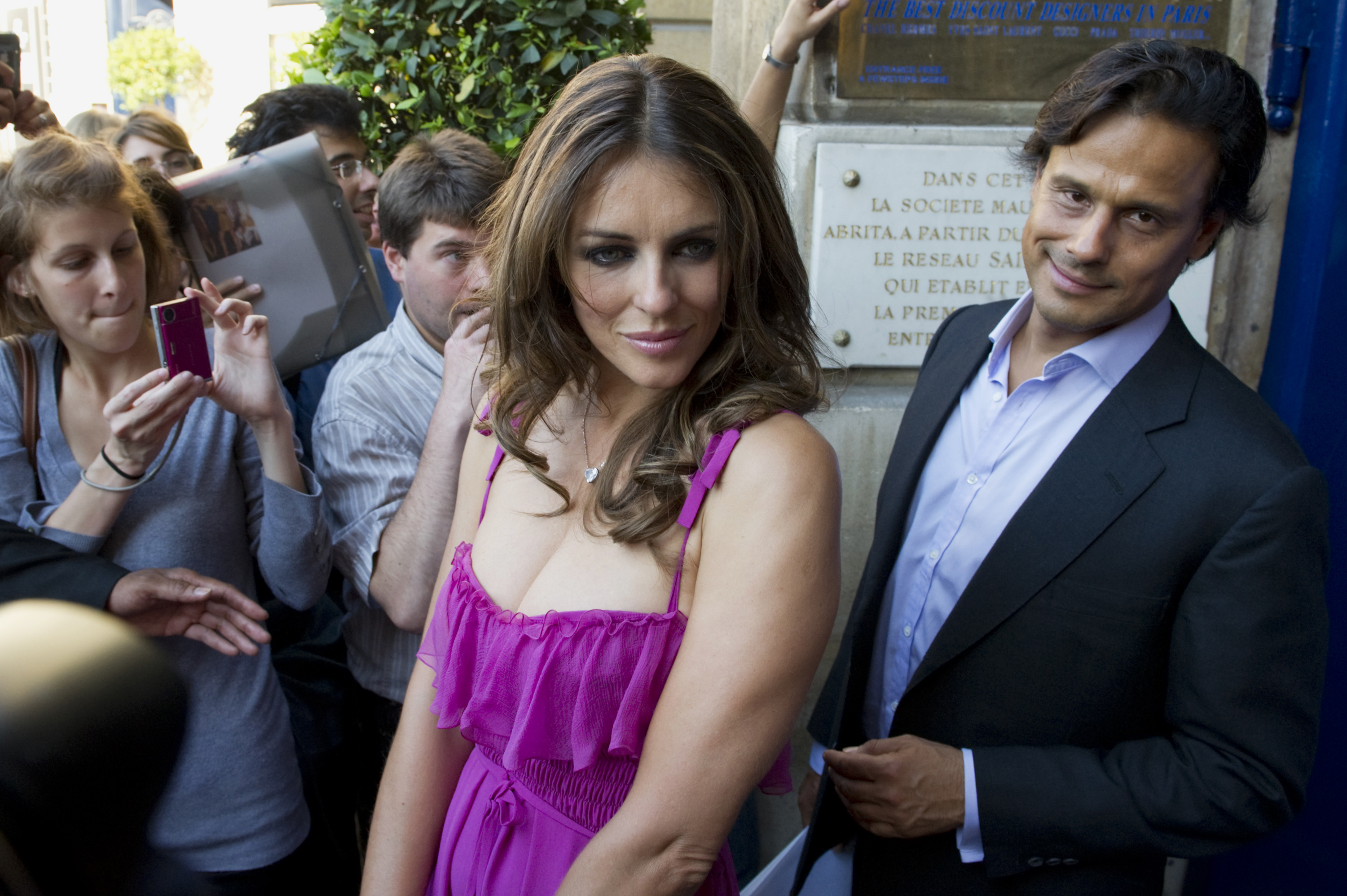 British model Elizabeth Hurley (L) and her husband, Indian businessman Arun Nayar leave after the Valentino fashion house Fall/Winter 2010-2011 Haute Couture show in Paris July 7, 2010. REUTERS/Gonzalo Fuentes (FRANCE - Tags: FASHION)