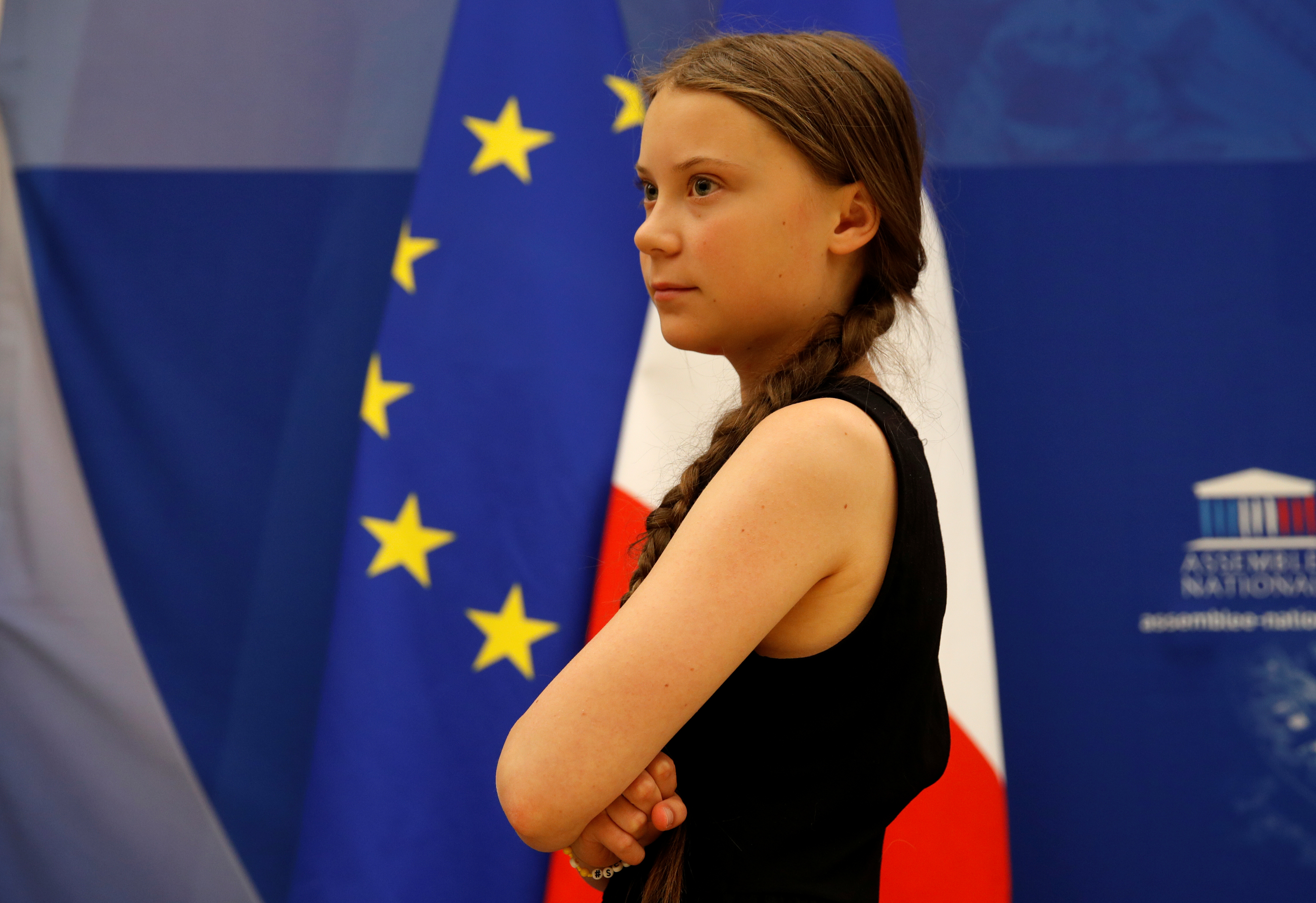 Swedish environmental activist Greta Thunberg leaves after a debate with French parliament members at the National Assembly in Paris, France, July 23, 2019.  REUTERS/Philippe Wojazer