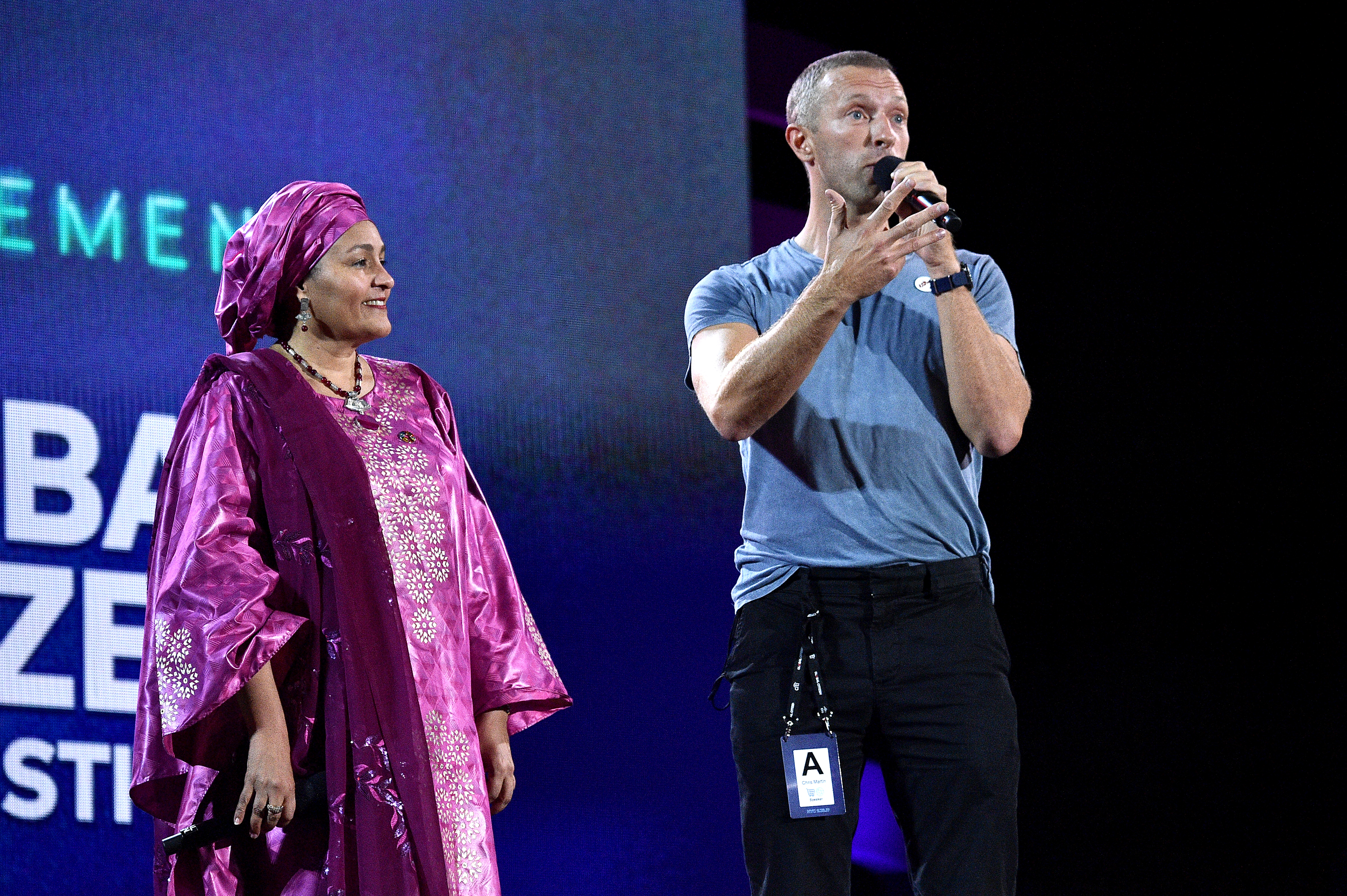 NEW YORK, NEW YORK - SEPTEMBER 28: Amina Mohammed (L) and Chris Martin speak onstage during the 2019 Global Citizen Festival: Power The Movement in Central Park on September 28, 2019 in New York City. (Photo by Theo Wargo/Getty Images for Global Citizen)