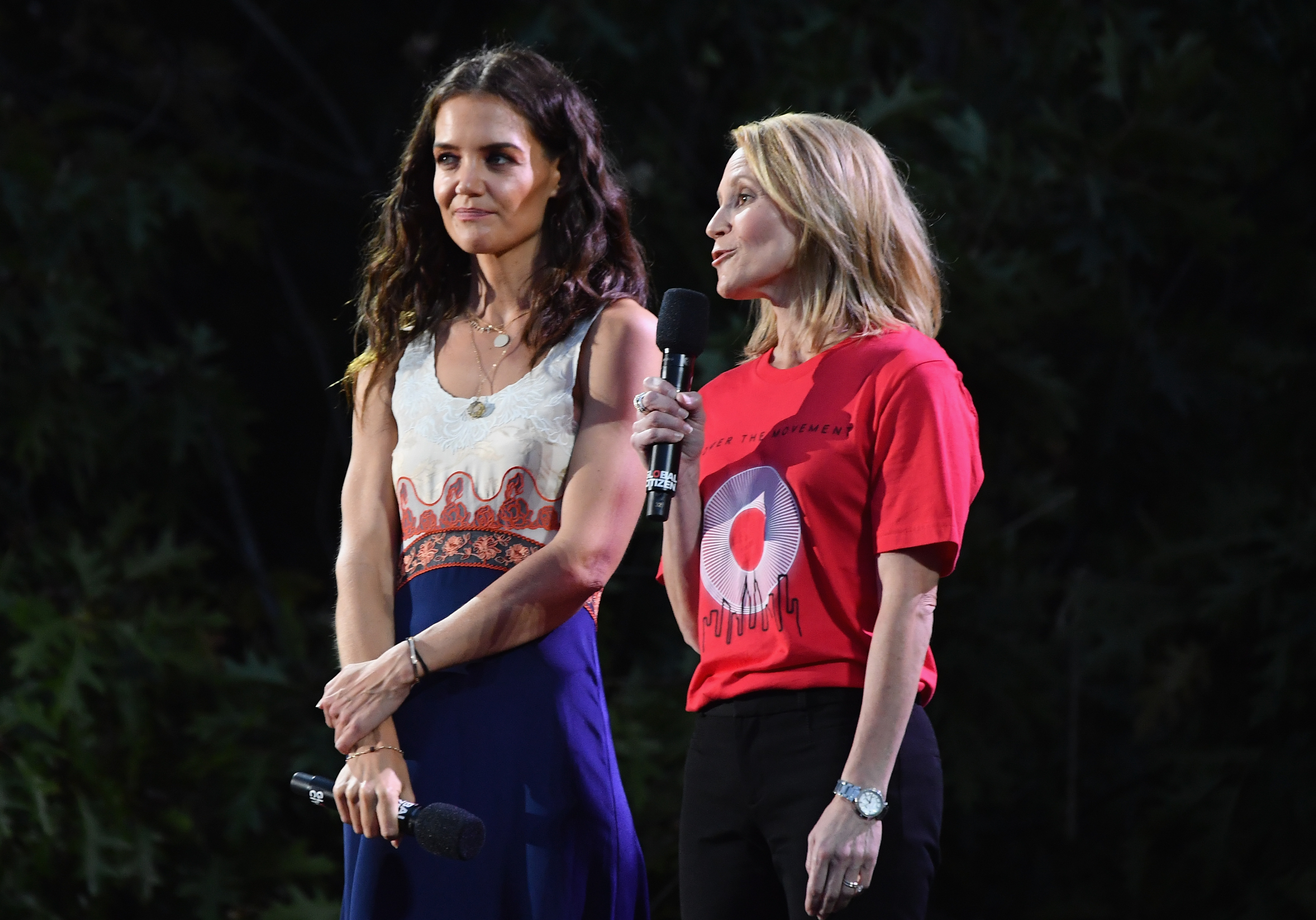 US actress Katie Holmes (L) and Proctor & Gamble President Feminine Care Jennifer Davis speak onstage at the 2019 Global Citizen Festival: Power The Movement in Central Park in New York on September 28, 2019. (Photo by Angela Weiss / AFP)        (Photo credit should read ANGELA WEISS/AFP/Getty Images)
