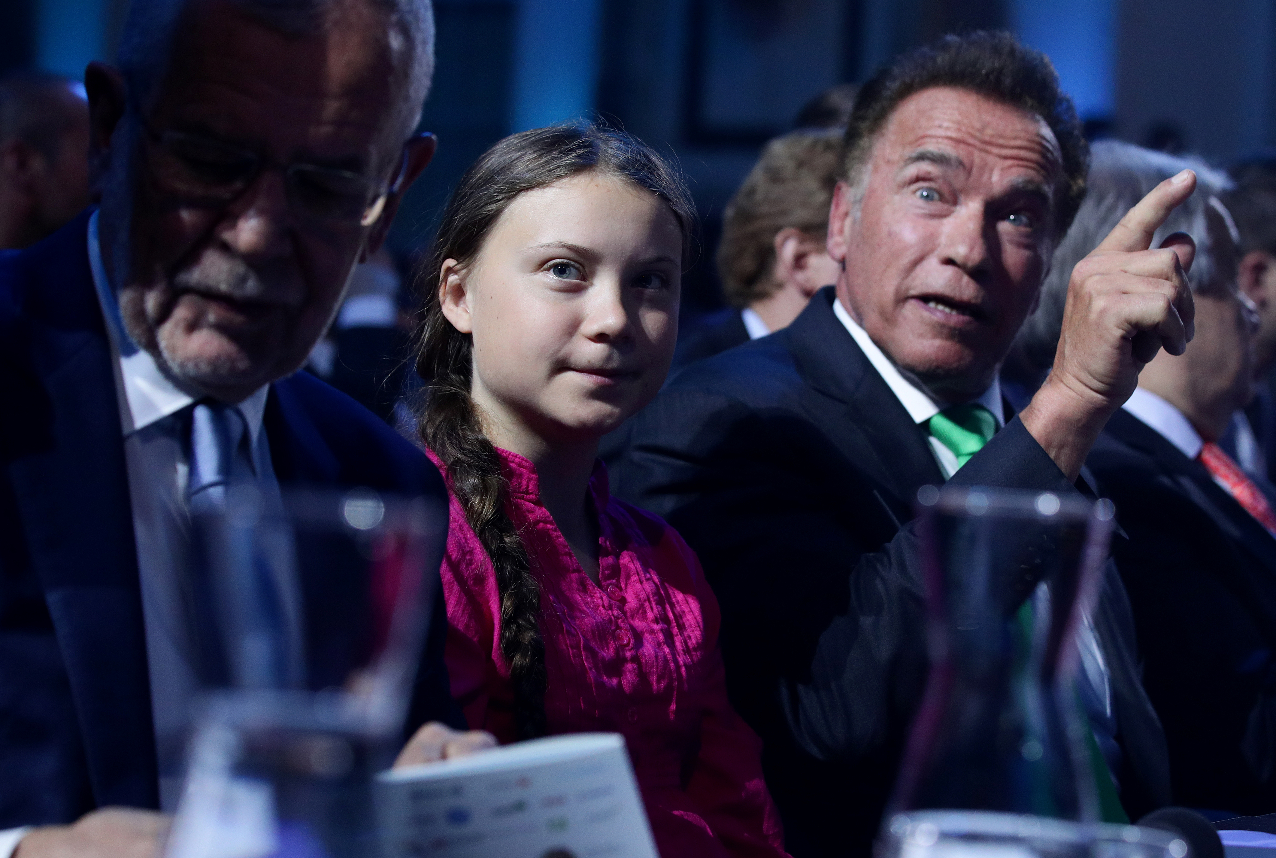 Former California Governor Arnold Schwarzenegger reacts next to Swedish climate activist Greta Thunberg and Austrian President Alexander Van der Bellen during the R20 Austrian World Summit in Vienna, Austria, May 28, 2019. REUTERS/Lisi Niesner