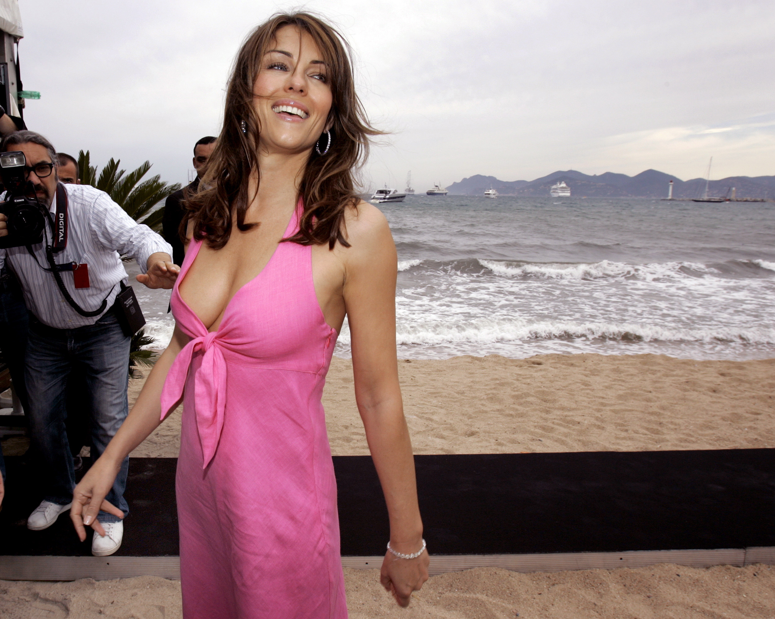 British actress Elizabeth Hurley poses for photographers during a beachside event to promote her swimwear range in Cannes, May 23, 2006.