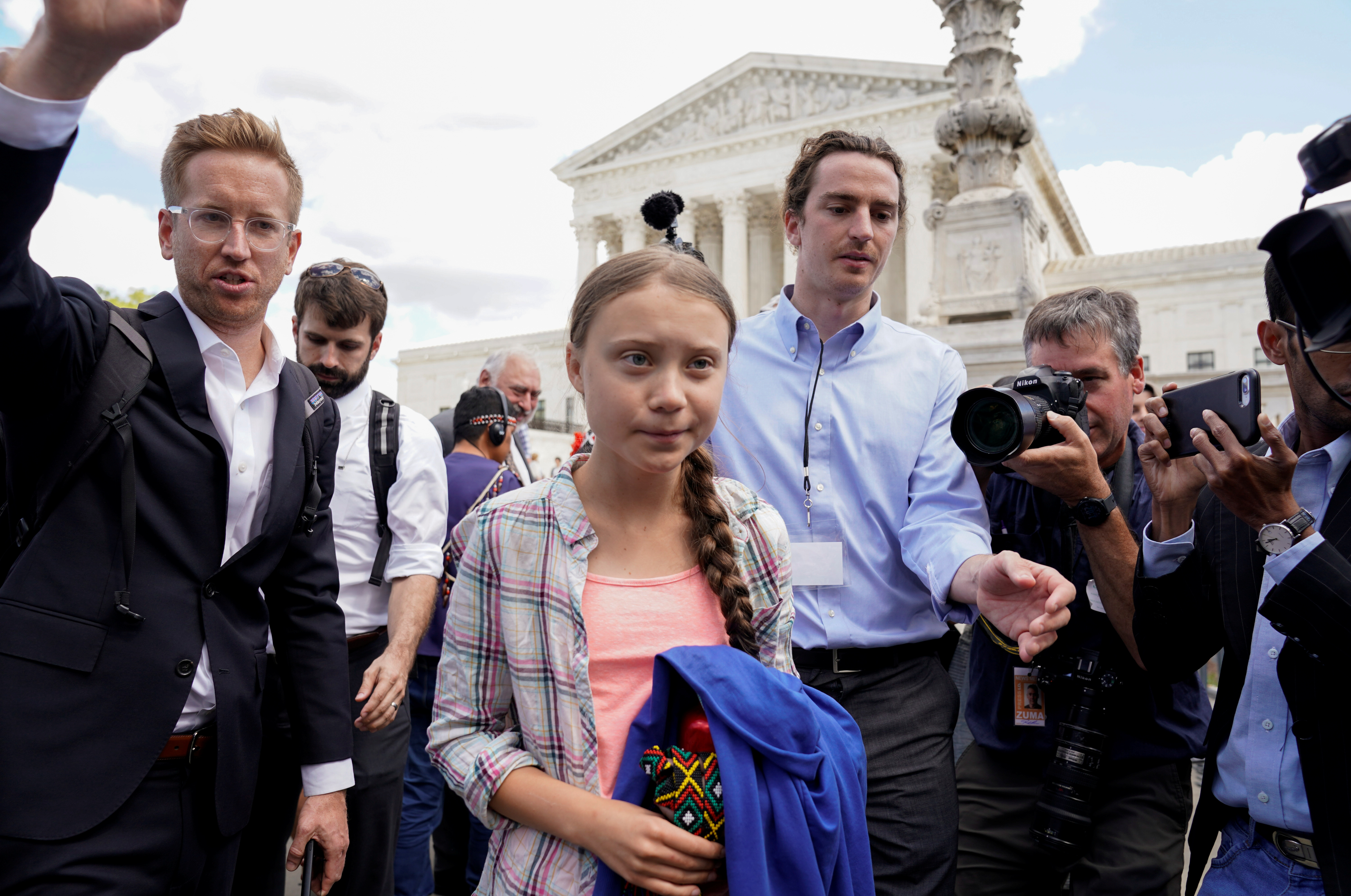 Sixteen year-old Swedish climate activist Greta Thunberg departs after attending a demonstration at the U.S. Supreme Court in Washington, U.S., September 18, 2019. REUTERS/Kevin Lamarque