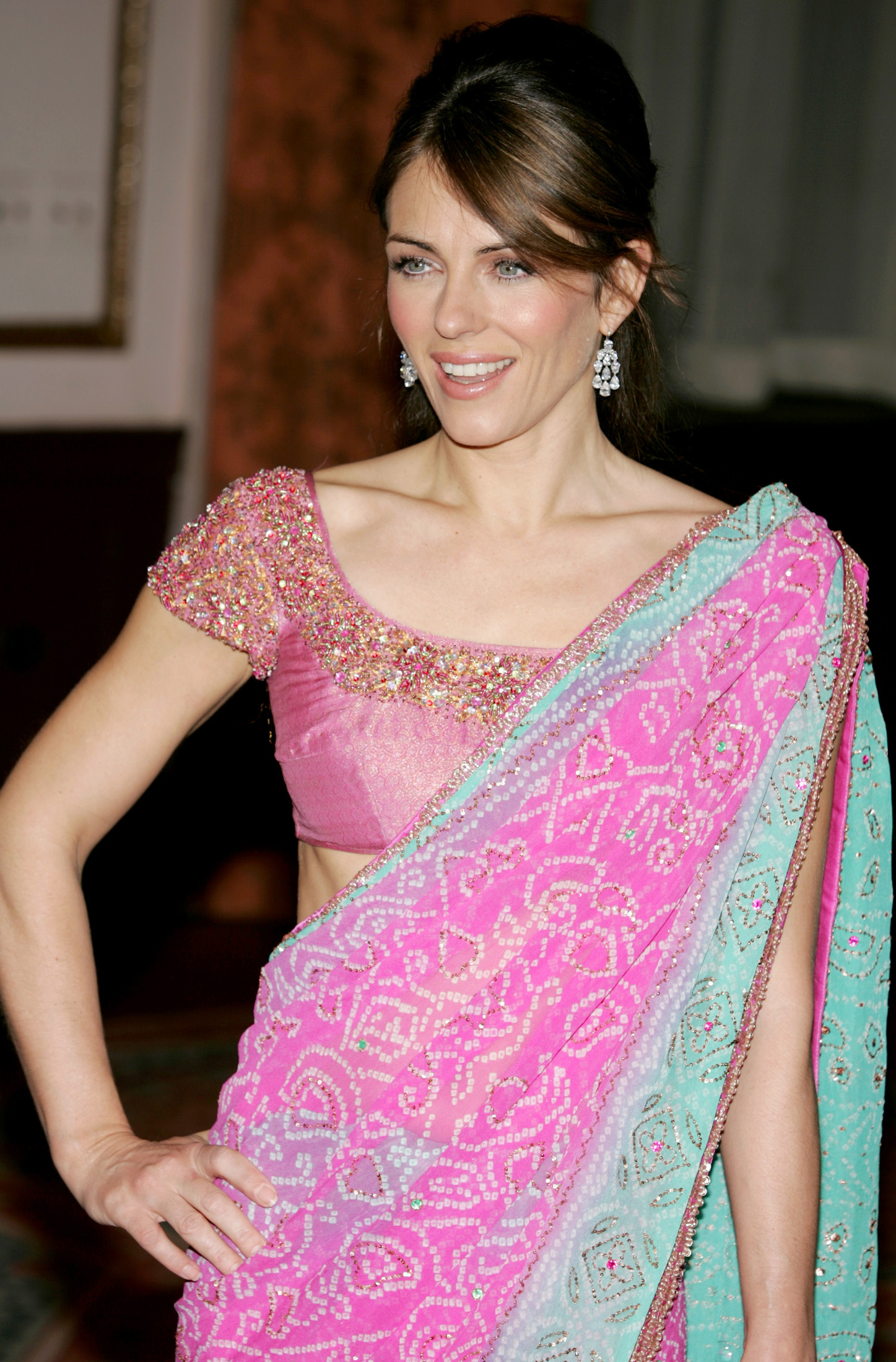 British Actress/model Elizabeth Hurley poses for the photographers as she arrives for The Breast Cancer Research Foundation's Annual Red Hot Pink Ball at The Waldorf-Astoria hotel in New York, April 20, 2005.