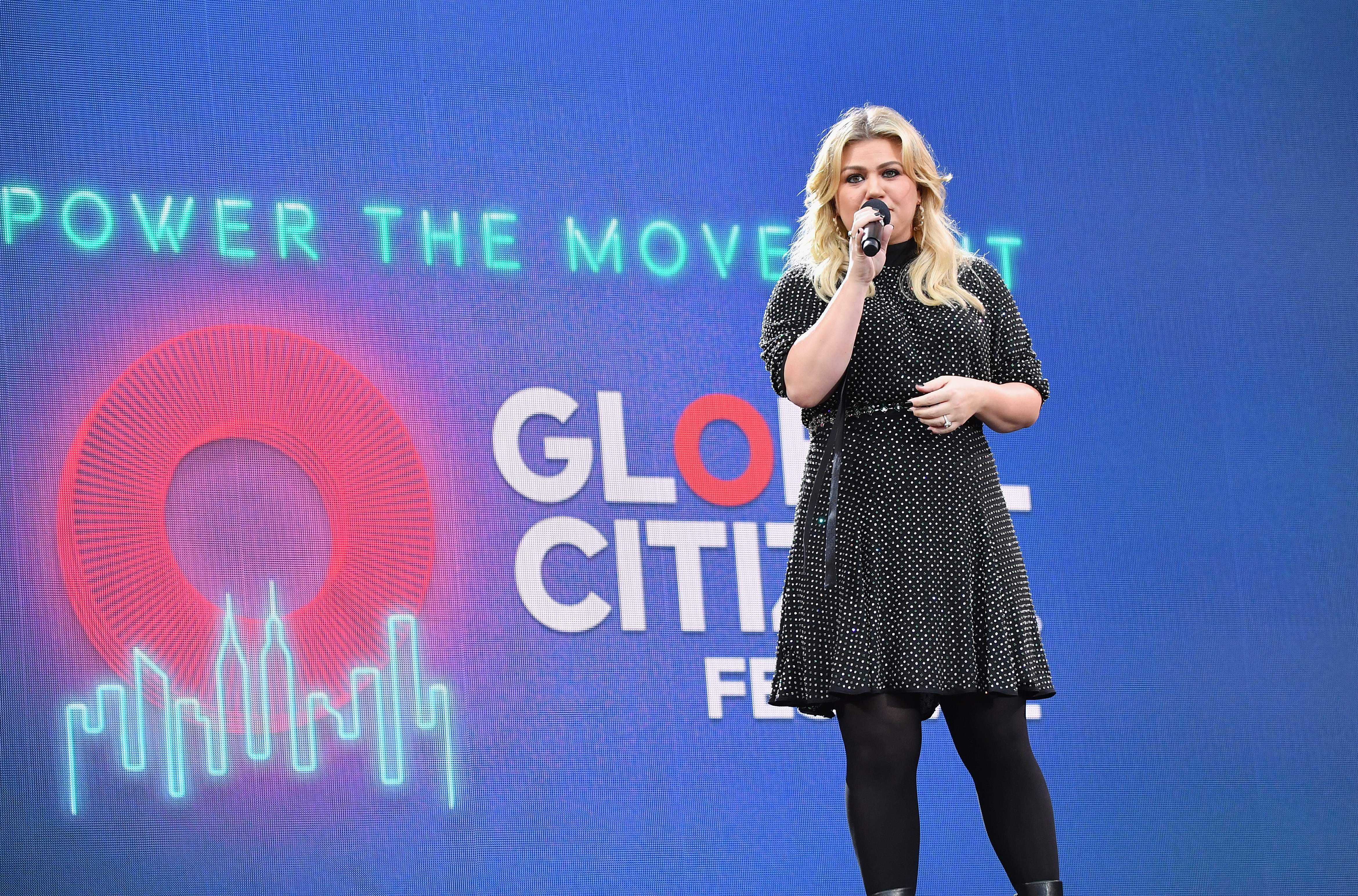 US singer and television presenter Kelly Clarkson speaks onstage at the 2019 Global Citizen Festival: Power The Movement in Central Park in New York on September 28, 2019. (Photo by Angela Weiss / AFP)        (Photo credit should read ANGELA WEISS/AFP/Getty Images)