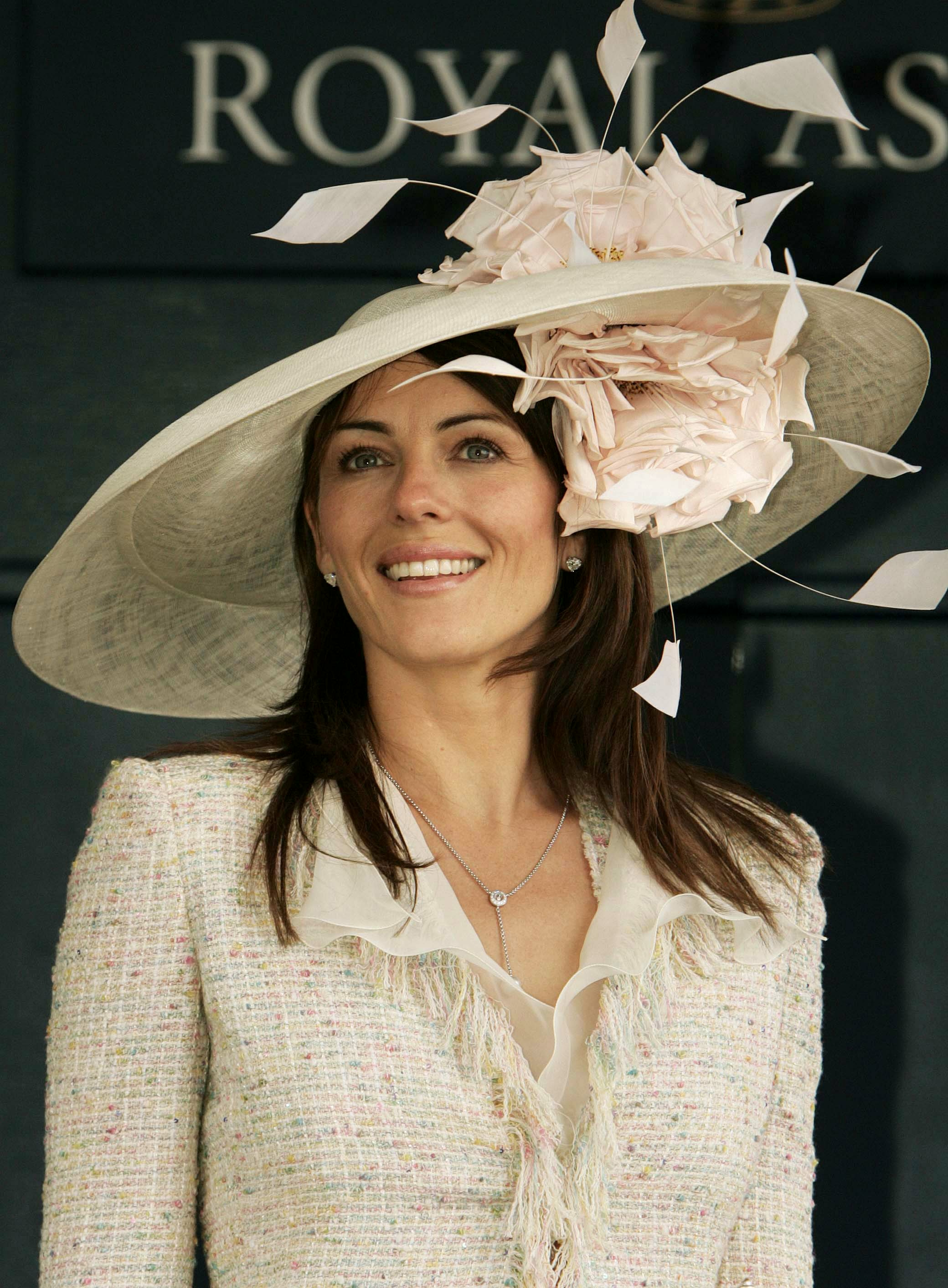 British actress Elizabeth Hurley attends Ladies Day at the Royal Ascot race meeting in southern England, June 17, 2004.