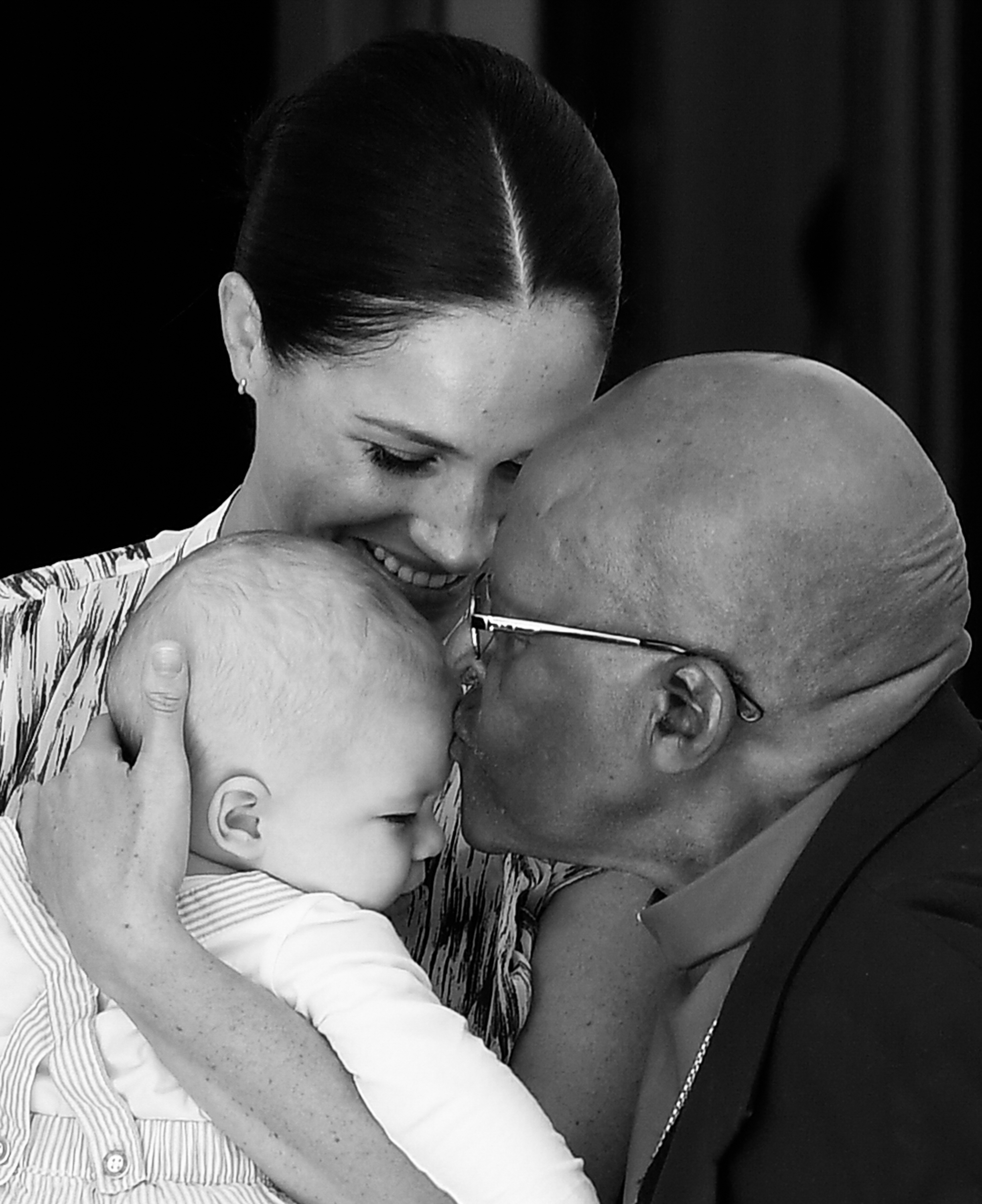 CAPE TOWN, SOUTH AFRICA - SEPTEMBER 25: (EDITORS NOTE: Image has been converted to black and white) Prince Harry, Duke of Sussex, Meghan, Duchess of Sussex and their baby son Archie Mountbatten-Windsor meet Archbishop Desmond Tutu and his daughter Thandeka Tutu-Gxashe at the Desmond & Leah Tutu Legacy Foundation during their royal tour of South Africa on September 25, 2019 in Cape Town, South Africa. (Photo by Toby Melville/Pool/Samir Hussein/WireImage)