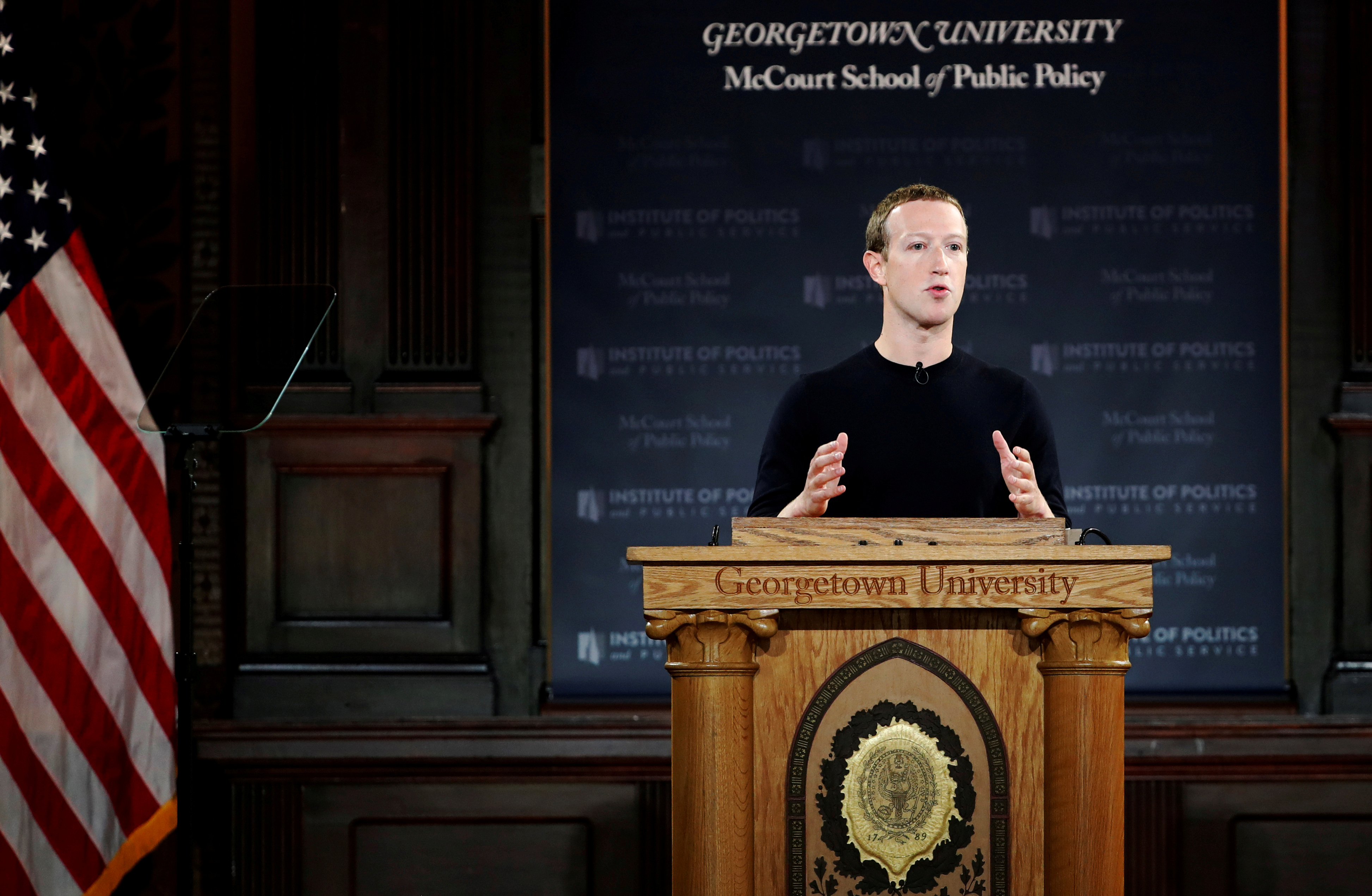 """Facebook Chairman and CEO Mark Zuckerberg addresses the audience on """"the challenges of protecting free speech while combating hate speech online, fighting misinformation, and political data privacy and security,"""" at a forum hosted by Georgetown University's Institute of Politics and Public Service (GU Politics) and the McCourt School of Public Policy in Washington, U.S., October 17, 2019. REUTERS/Carlos Jasso"""