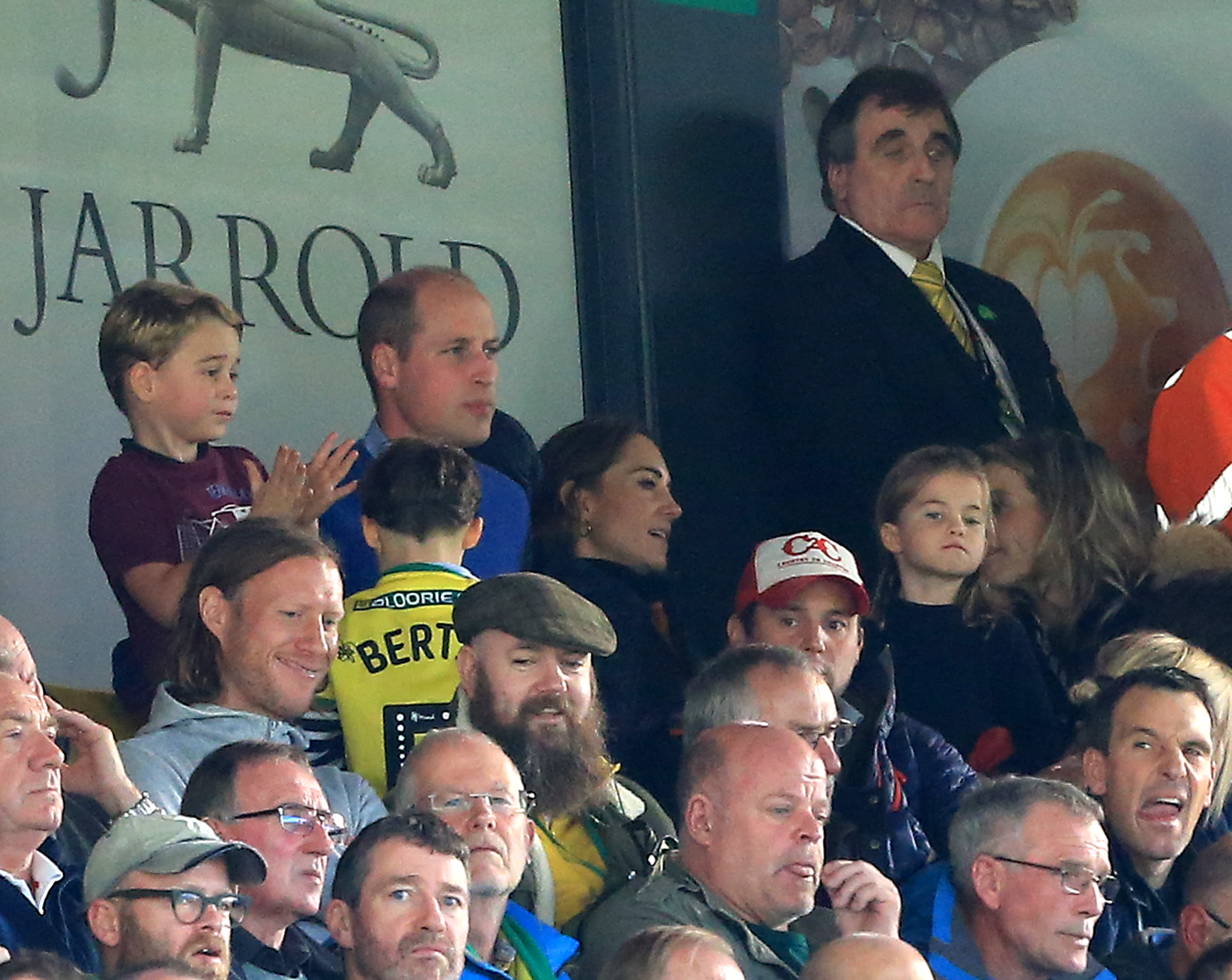 NORWICH, ENGLAND - OCTOBER 05: Prince George of Cambridge,  Prince William, Duke of Cambridge and Catherine, Duchess of Cambridge and Princess Charlotte of Cambridge are seen in the stands during the Premier League match between Norwich City and Aston Villa at Carrow Road on October 05, 2019 in Norwich, United Kingdom. (Photo by Stephen Pond/Getty Images)