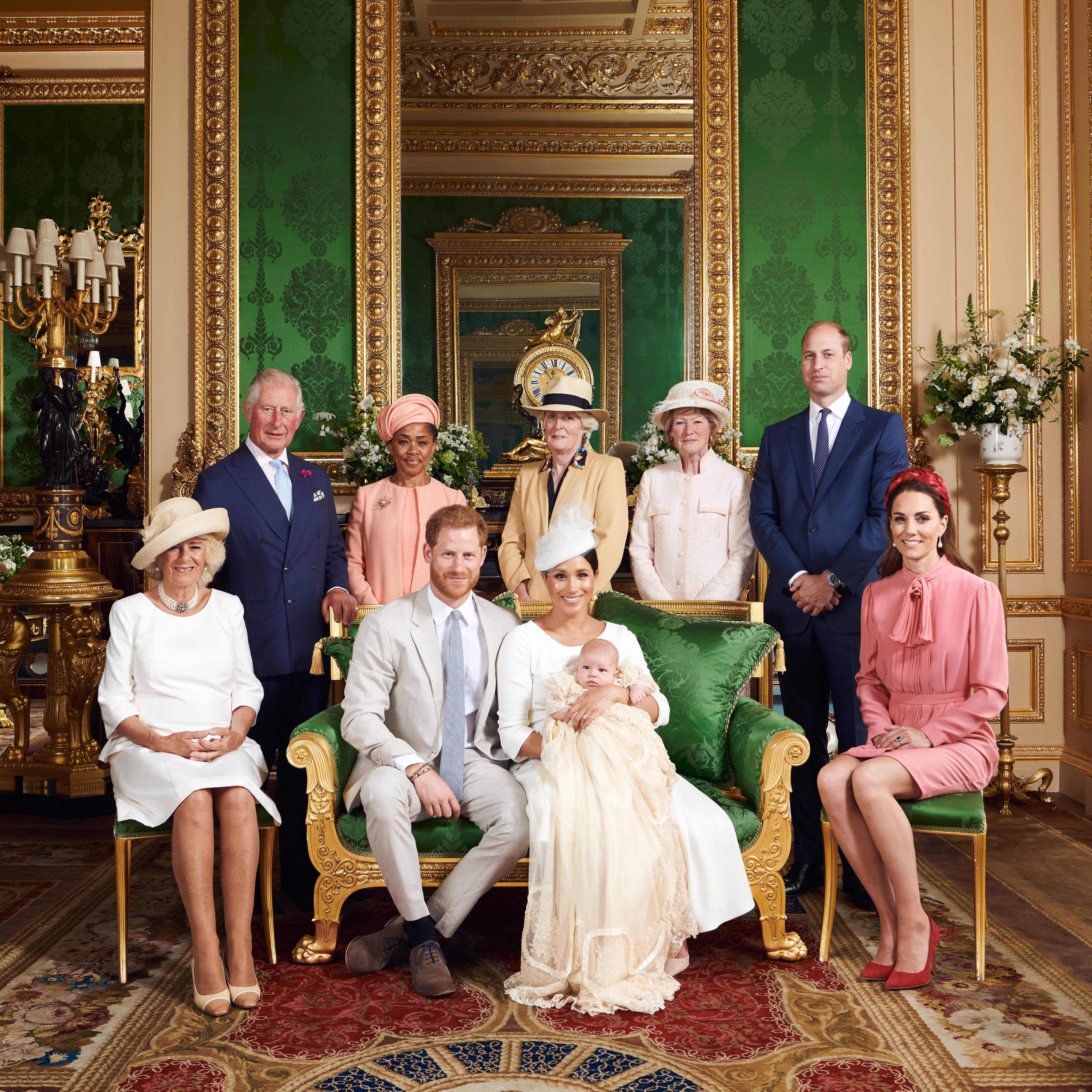 """TOPSHOT - This official handout Christening photograph released by the Duke and Duchess of Sussex shows Britain's Prince Harry, Duke of Sussex (centre left), and his wife Meghan, Duchess of Sussex holding their baby son, Archie Harrison Mountbatten-Windsor flanked by (L-R) Britain's Camilla, Duchess of Cornwall, Britain's Prince Charles, Prince of Wales, Ms Doria Ragland, Lady Jane Fellowes, Lady Sarah McCorquodale, Britain's Prince William, Duke of Cambridge, and Britain's Catherine, Duchess of Cambridge in the Green Drawing Room at Windsor Castle, west of London on July 6, 2019. - Prince Harry and his wife Meghan had their baby son Archie christened on Saturday at a private ceremony. (Photo by Chris ALLERTON / SUSSEXROYAL / AFP) / XGTY / RESTRICTED TO EDITORIAL USE - MANDATORY CREDIT """"AFP PHOTO / SUSSEXROYAL / CHRIS ALLERTON"""" - NO MARKETING NO ADVERTISING CAMPAIGNS - NO COMMERCIAL USE - NO THIRD PARTY SALES - RESTRICTED TO SUBSCRIPTION USE - NO CROPPING OR MODIFICATION - NOT FOR USE AFTER DECEMBER 31, 2019 - DISTRIBUTED AS A SERVICE TO CLIENTS /         (Photo credit should read CHRIS ALLERTON/AFP/Getty Images)"""