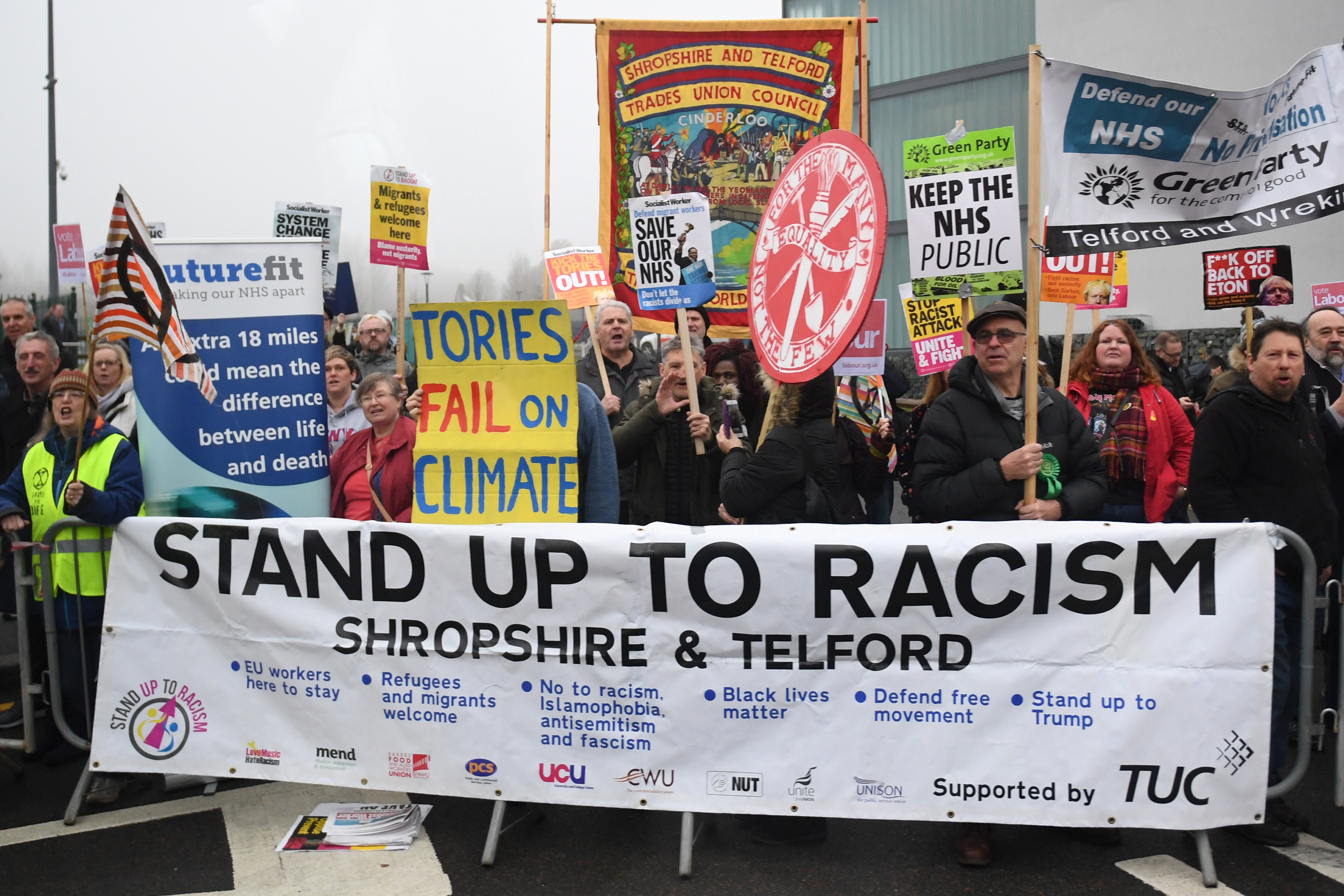 Protesters wait for the arrival of Prime Minister Boris Johnson ahead of the launch of his party's manifesto at Telford International Centre in Telford, West Midlands.