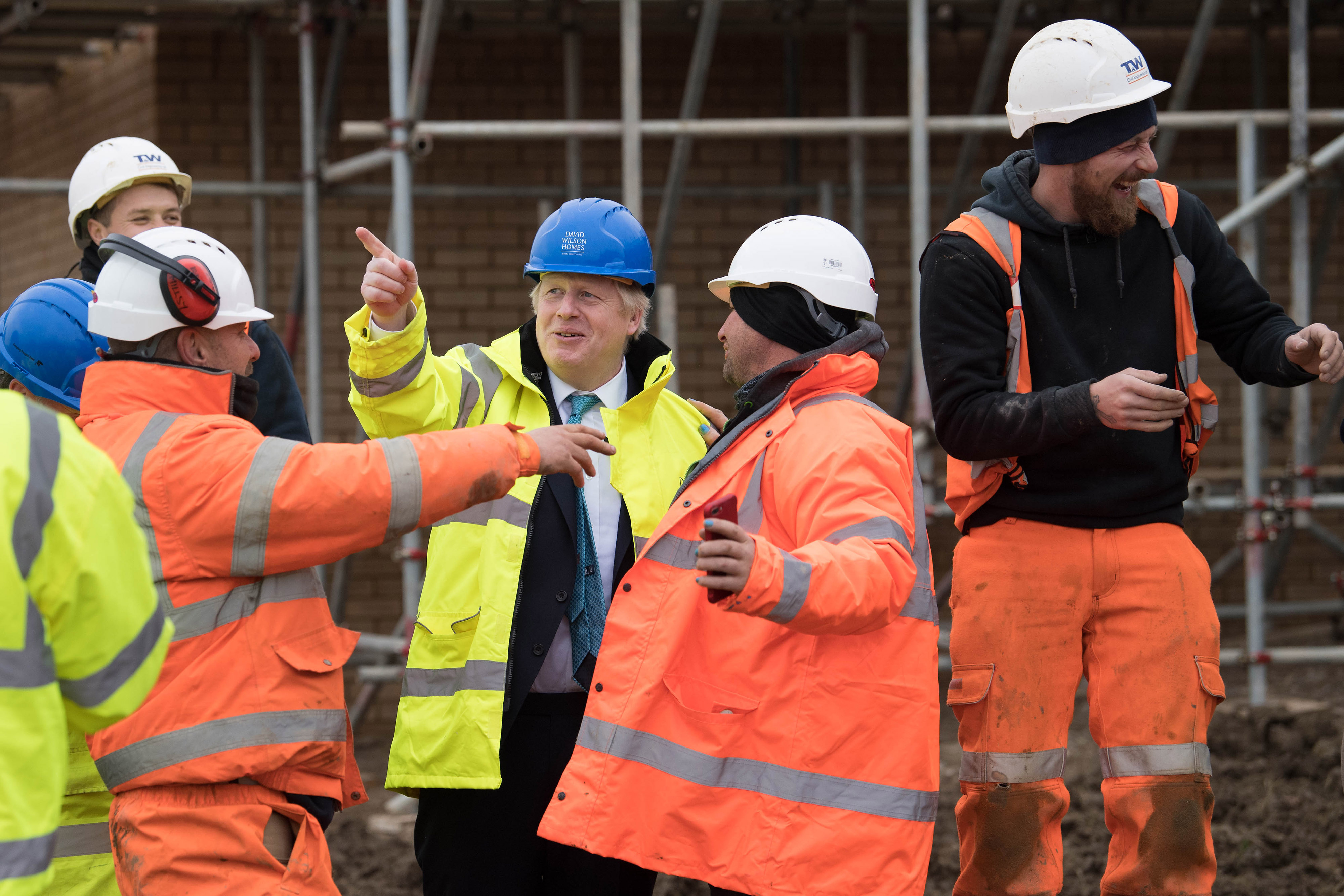 Prime Minister Boris Johnson (centre) during a visit to David Wilson Homes in Bedford while on the campaign trail for the General Election.