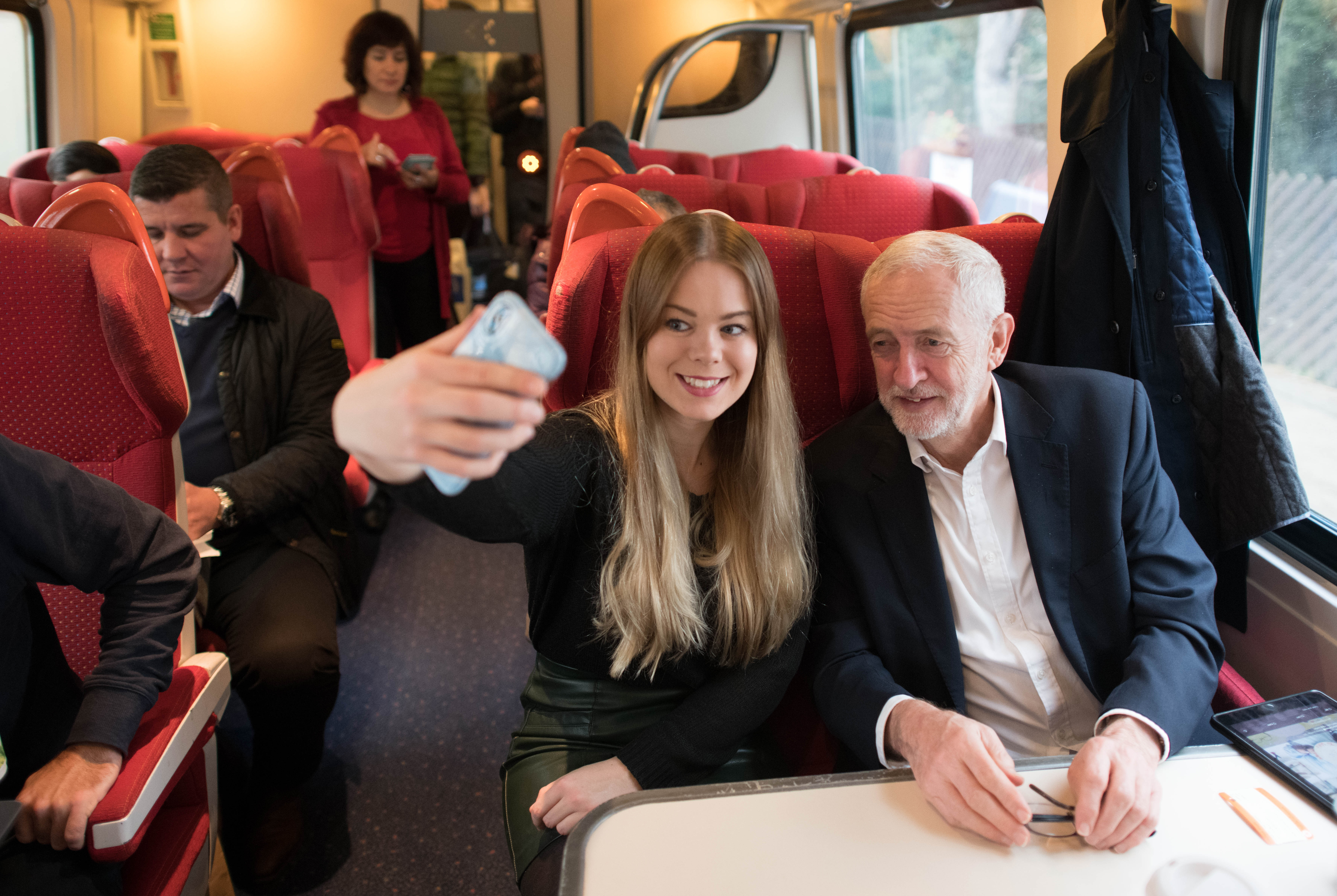 Labour Party leader Jeremy Corbyn meets a supporter on a train on his return from a visit to Sheffield, South Yorkshire, while on the General Election campaign trail.
