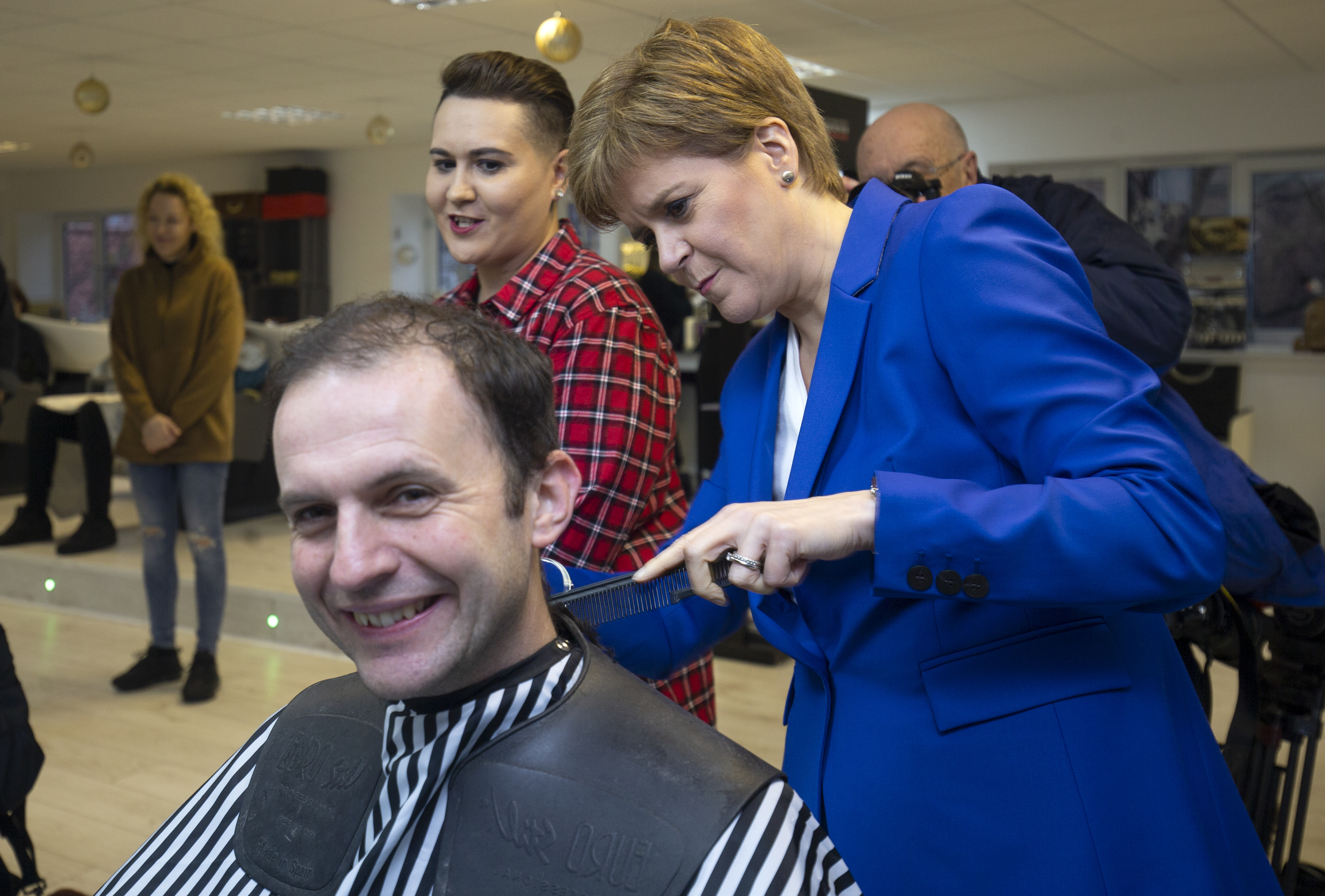 SNP leader Nicola Sturgeon gives her party's candidate for North East Fife Stephen Gethins a haircut, during a visit to Craig Boyd Hairdressing in Leven, Fife, whilst on the General Election campaign trail.