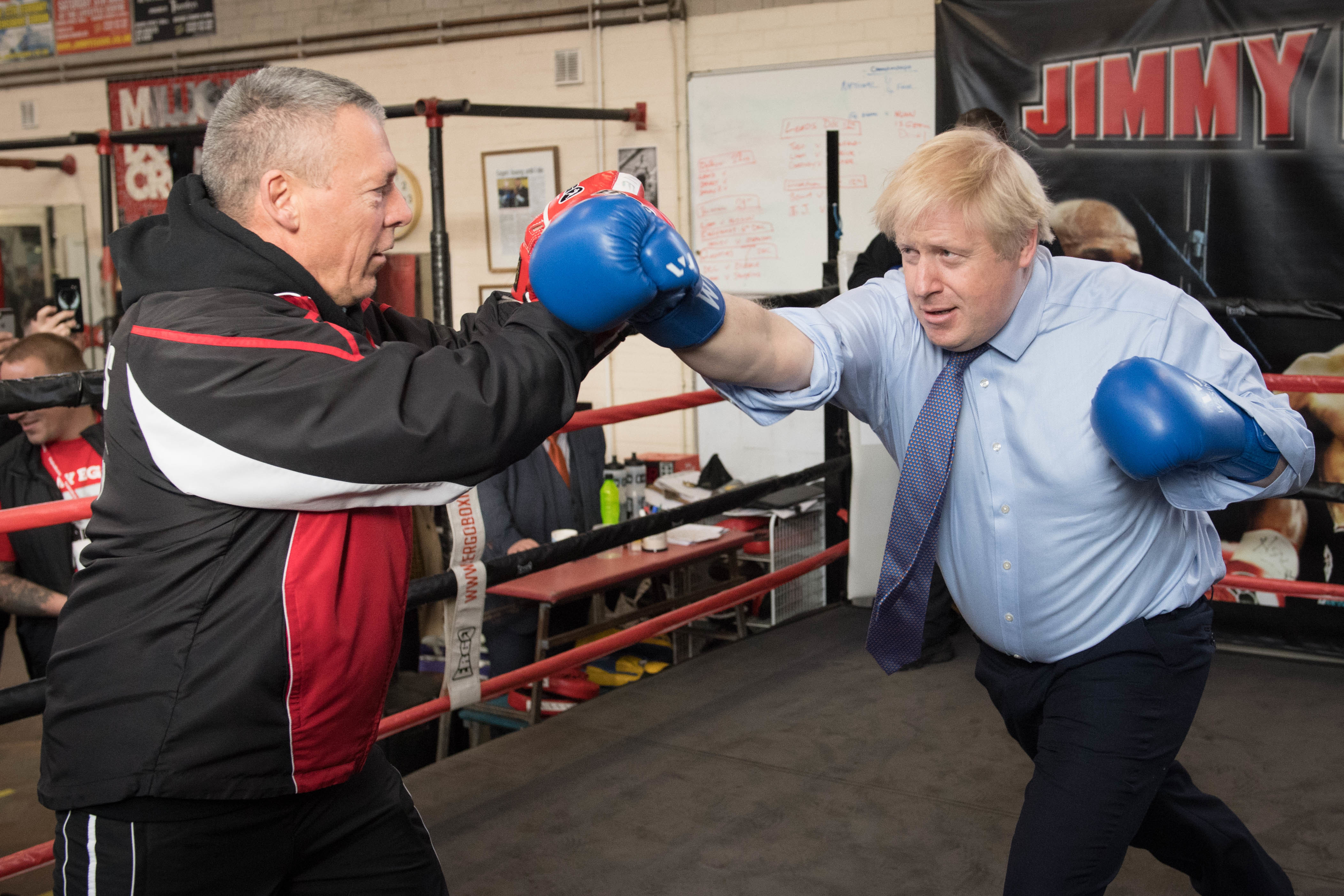 Prime Minister Boris Johnson spars with boxing coach, Steve Egan during a visit to Jimmy Egan's Boxing Academy at Wythenshawe, while on the campaign trail ahead of the General Election. PA Photo. Picture date: Tuesday November 19, 2019. See PA story POLITICS Election. Photo credit should read: Stefan Rousseau/PA Wire