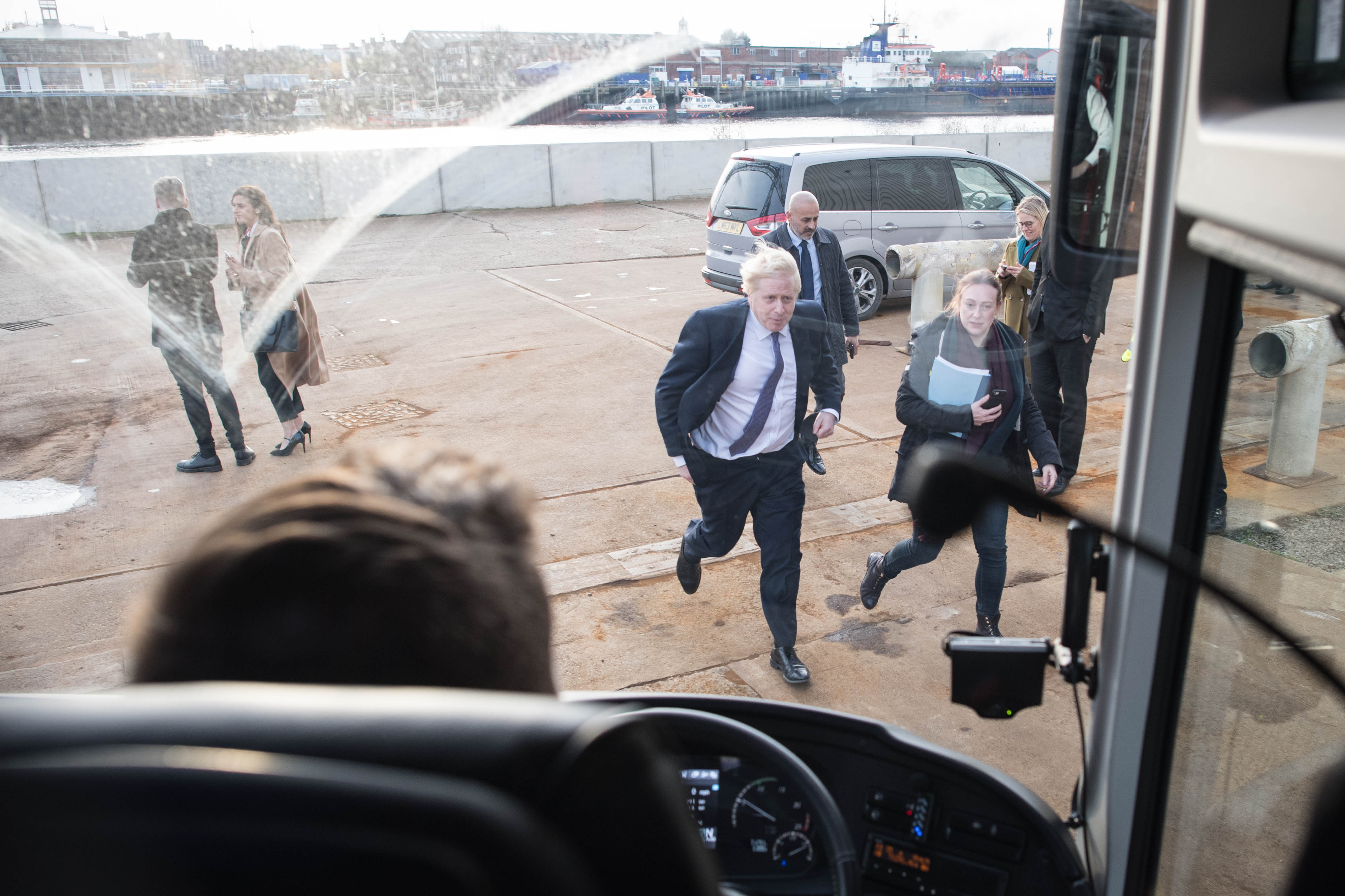 Prime Minister Boris Johnson makes his way back onto his battle bus after visiting Wilton Engineering Services in Middlesbrough while on the campaign trail for the General Election.
