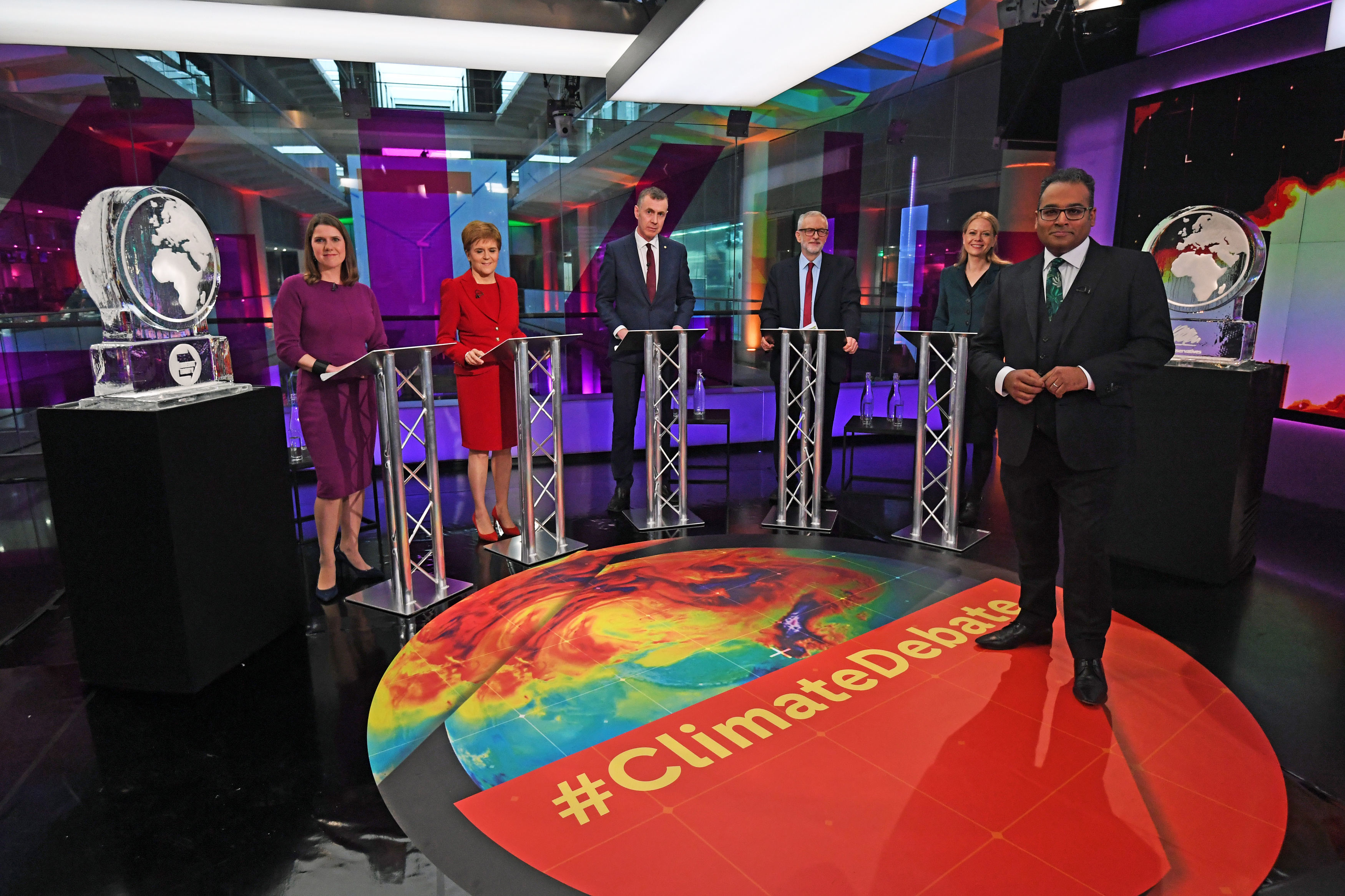 RETRANSMITTED WITH CORRECT CAPTION Krishnan Guru-Murthy (foreground) with (rear left to right) Liberal Democrat leader Jo Swinson, SNP leader Nicola Sturgeon, Plaid Cymru leader Adam Price, Labour Party leader Jeremy Corbyn and Green Party Co-Leader Sian Berry, standing next to ice sculptures representing the Brexit Party and Conservative Party who didn't appear at the event, before the start of the Channel 4 News' General Election climate debate at ITN Studios in Holborn, central London.