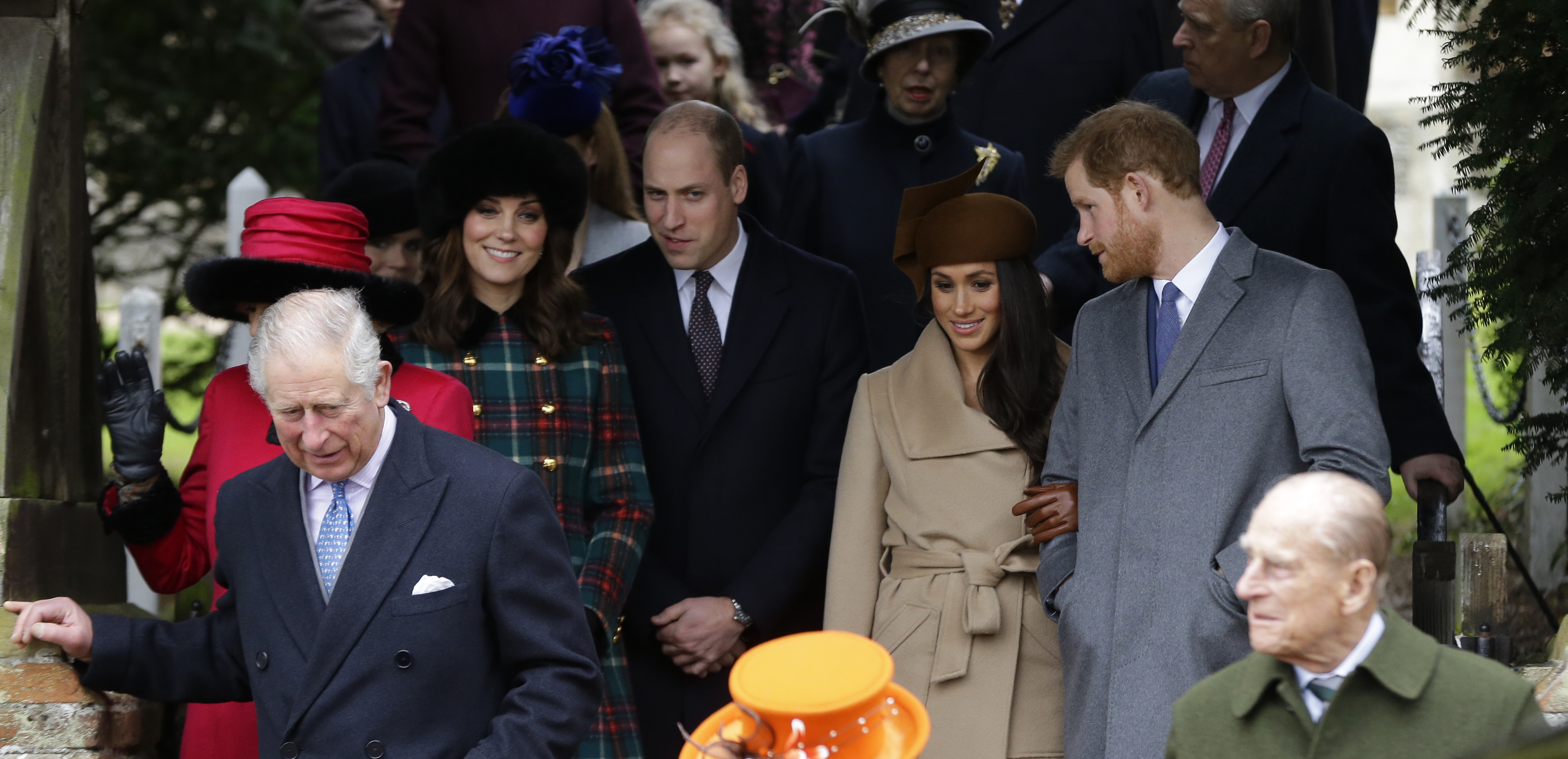 Britain's Prince Charles, left, Kate, Duchess of Cambridge, 2nd left, Price William, Meghan Markle, fiancee of Prince Harry, 2nd right and Prince Philip, right, as they wait for the Queen to leave by car following the traditional Christmas Day church service, at St. Mary Magdalene Church in Sandringham, England, Monday, Dec. 25, 2017. (AP Photo/Alastair Grant)