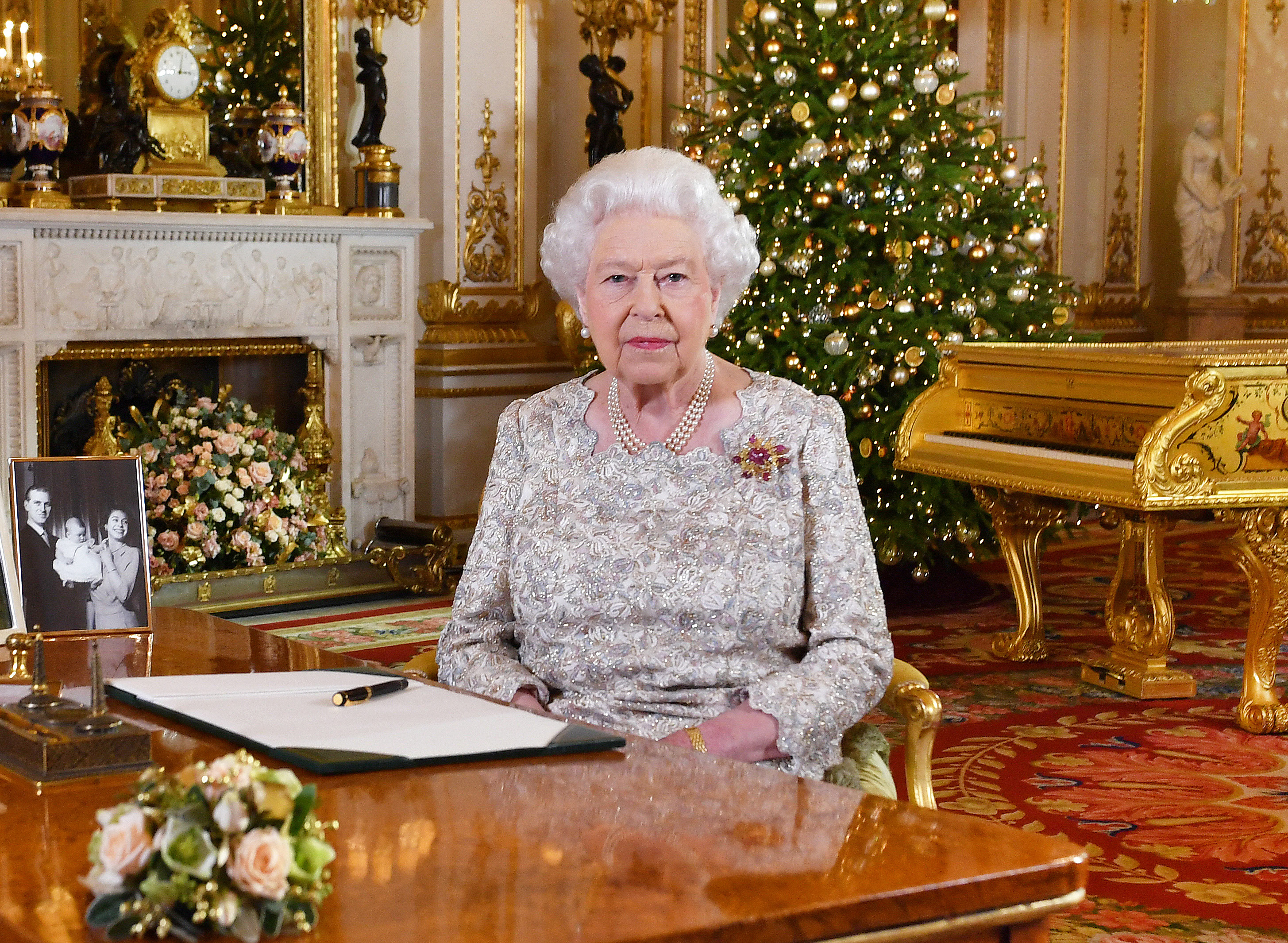 TOPSHOT - A picture released on December 24, 2018 shows Britain's Queen Elizabeth II posing for a photograph after she recorded her annual Christmas Day message, in the White Drawing Room of Buckingham Palace in central London. (Photo by John Stillwell / POOL / AFP)        (Photo credit should read JOHN STILLWELL/AFP via Getty Images)