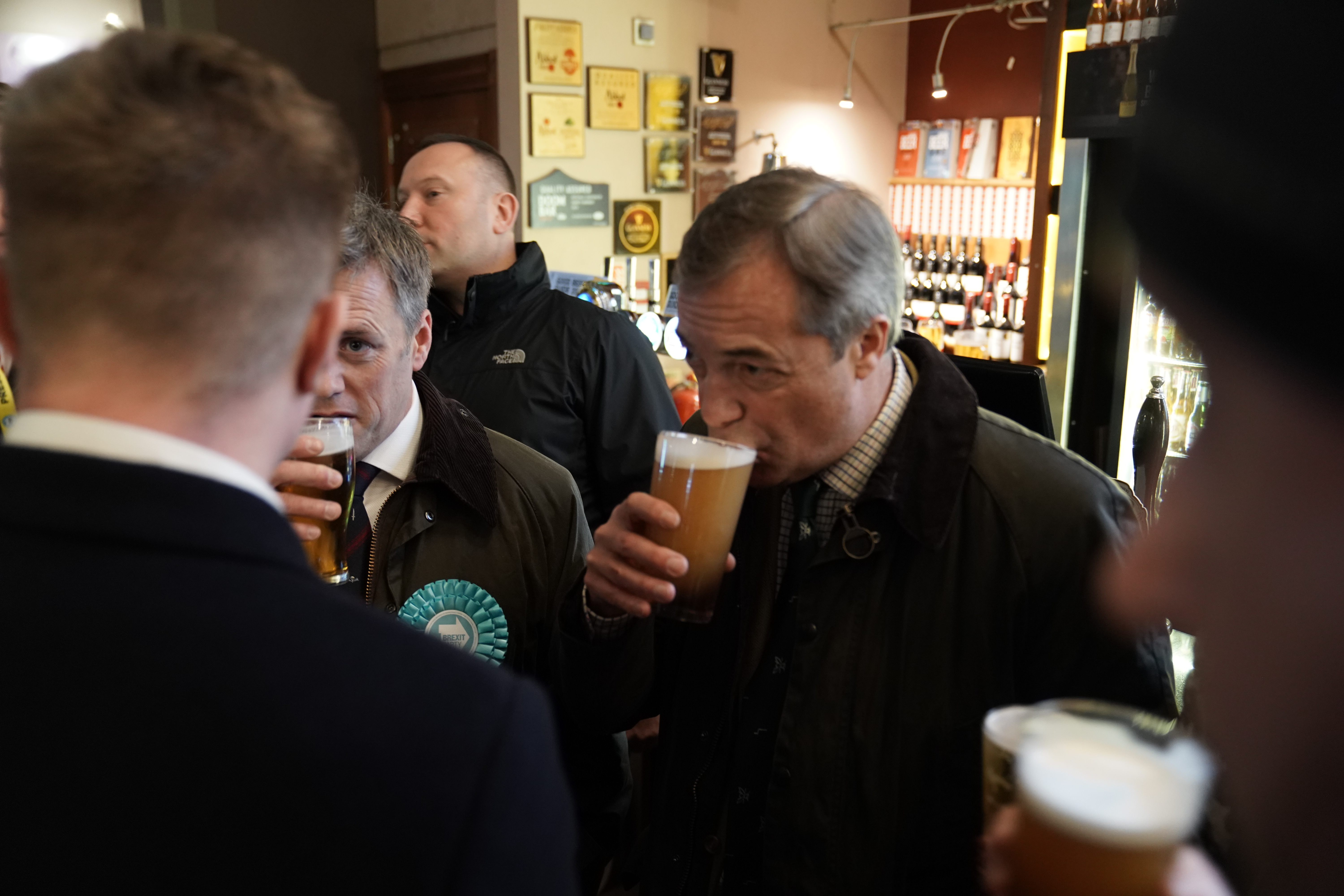 Brexit Party leader Nigel Farage sips a pint in a pub in Hull, East Yorkshire, whilst on the General Election campaign trail.