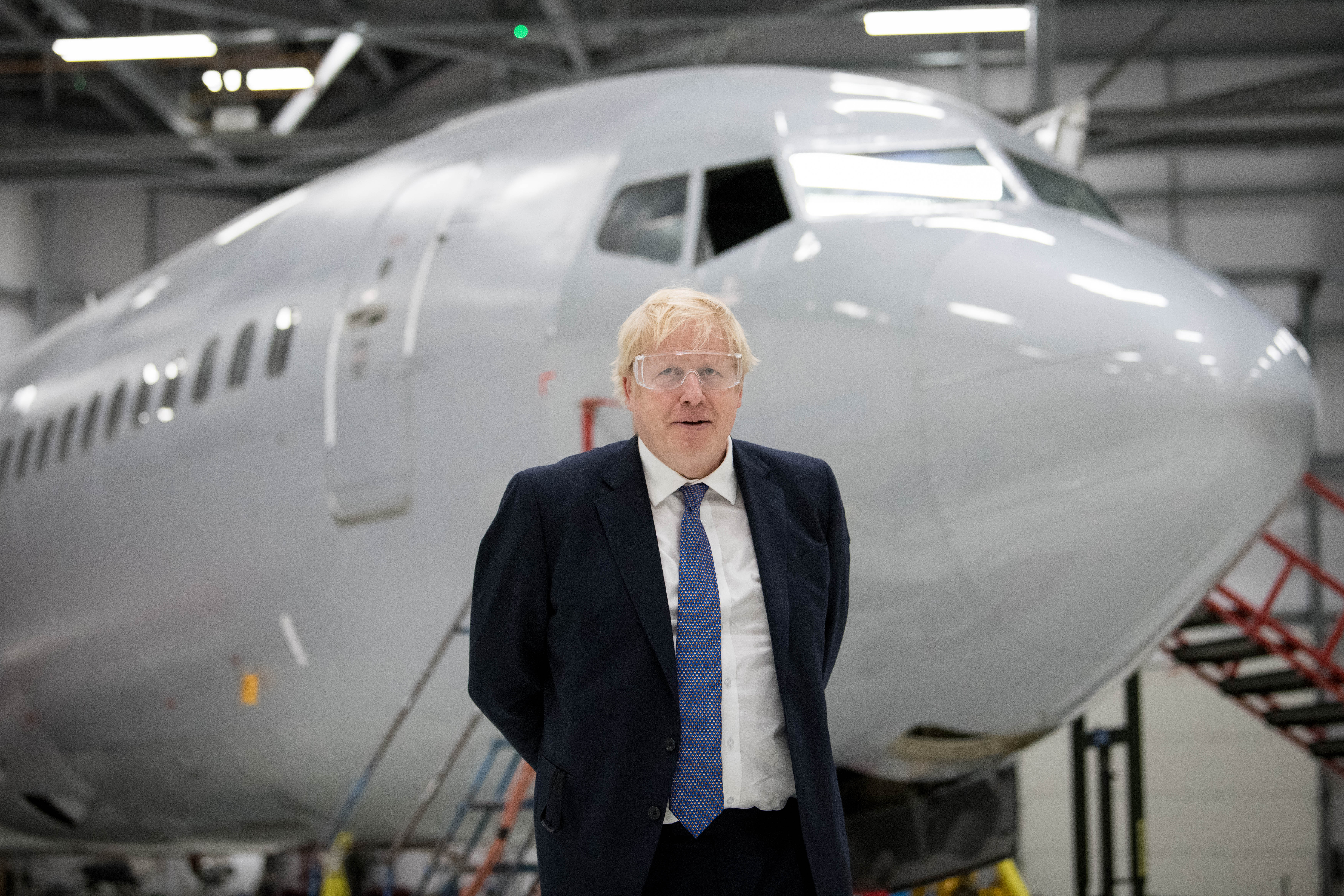 Prime Minister Boris Johnson in a hangar on a visit to the International Aviation Academy, Norwich, whilst on the General Election campaign trail.