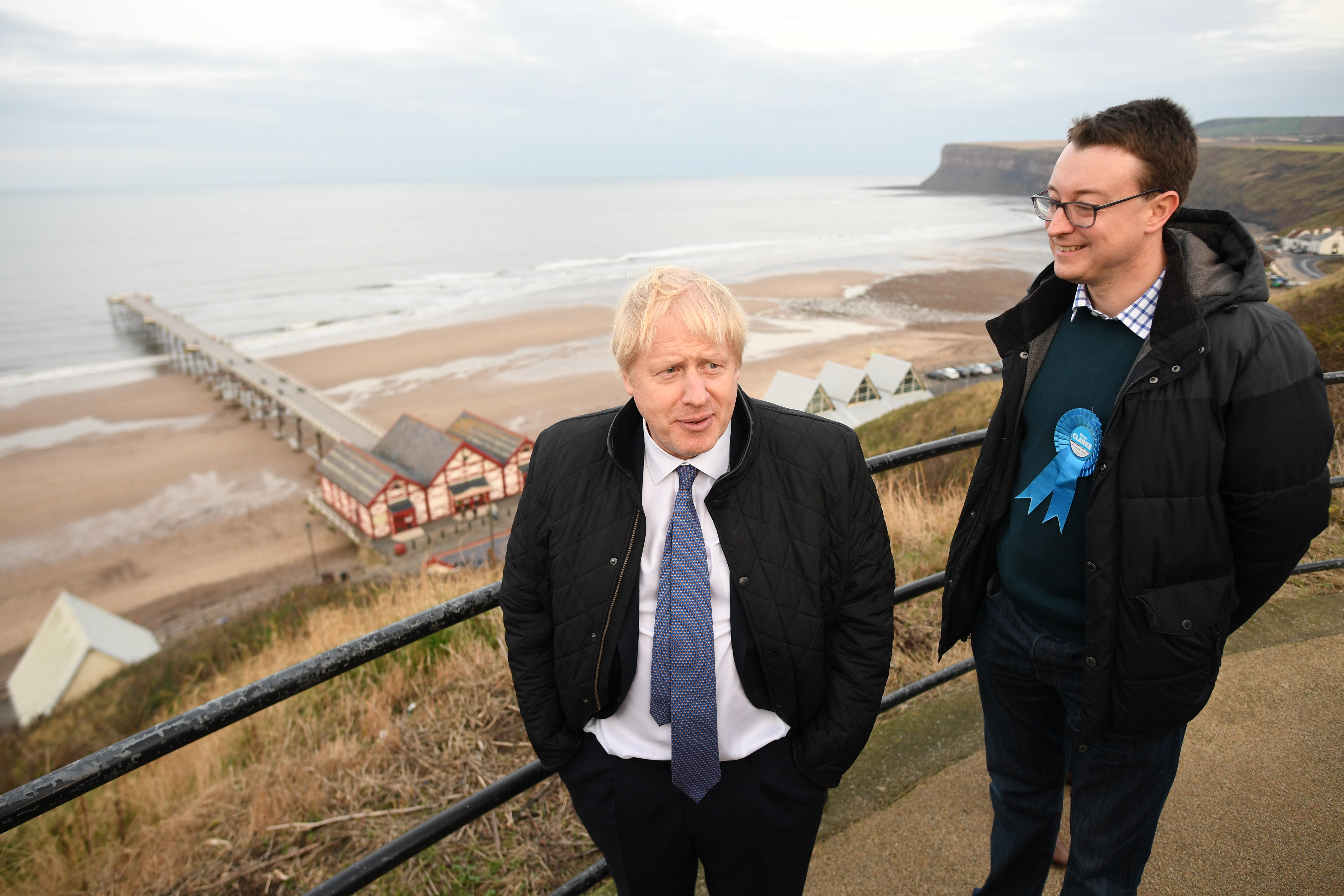 Prime Minister Boris Johnson outside the Seaview restaurant in Saltburn-by-the-Sea, with his party's candidate for Middlesbrough South and East Cleveland Simon Clarke, while on the campaign trail for the General Election.