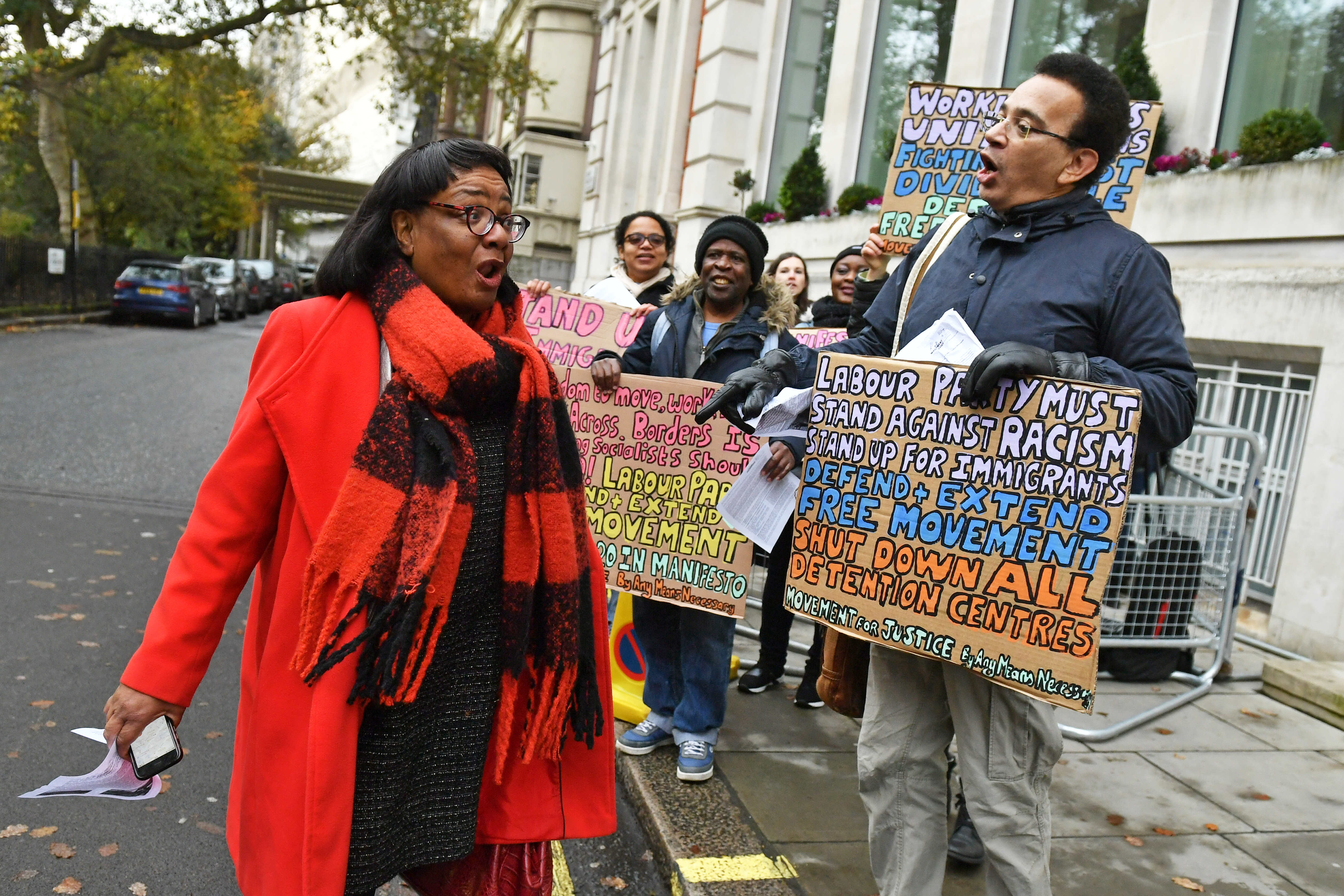 Shadow home secretary Diane Abbott is greeted by pro-immigration protesters as she arrives for a Labour clause V meeting on the manifesto at Savoy Place in London.