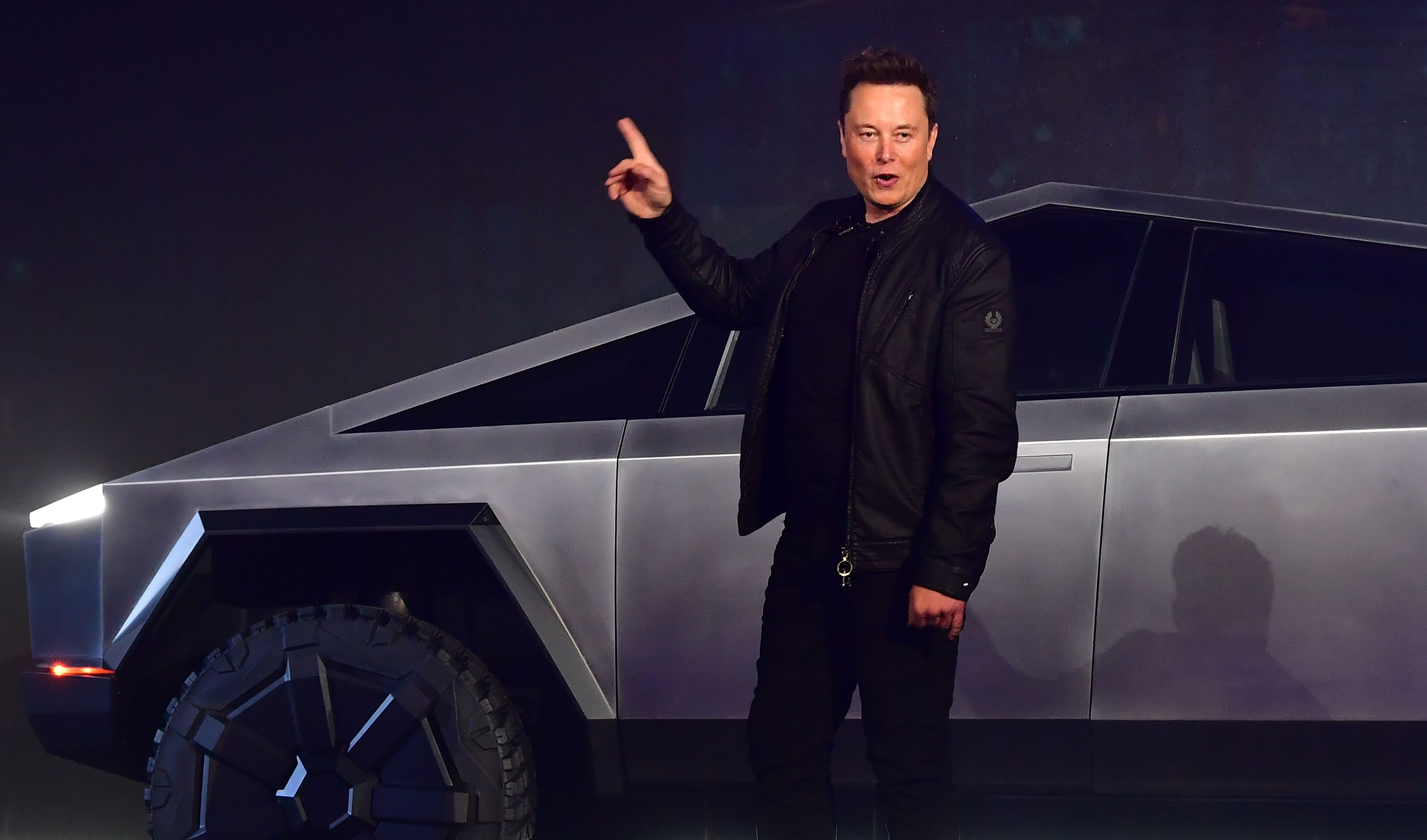 Tesla co-founder and CEO Elon Musk gestures while introducing the newly unveiled all-electric battery-powered Tesla Cybertruck at Tesla Design Center in Hawthorne, California on November 21, 2019. (Photo by Frederic J. BROWN / AFP) (Photo by FREDERIC J. BROWN/AFP via Getty Images)