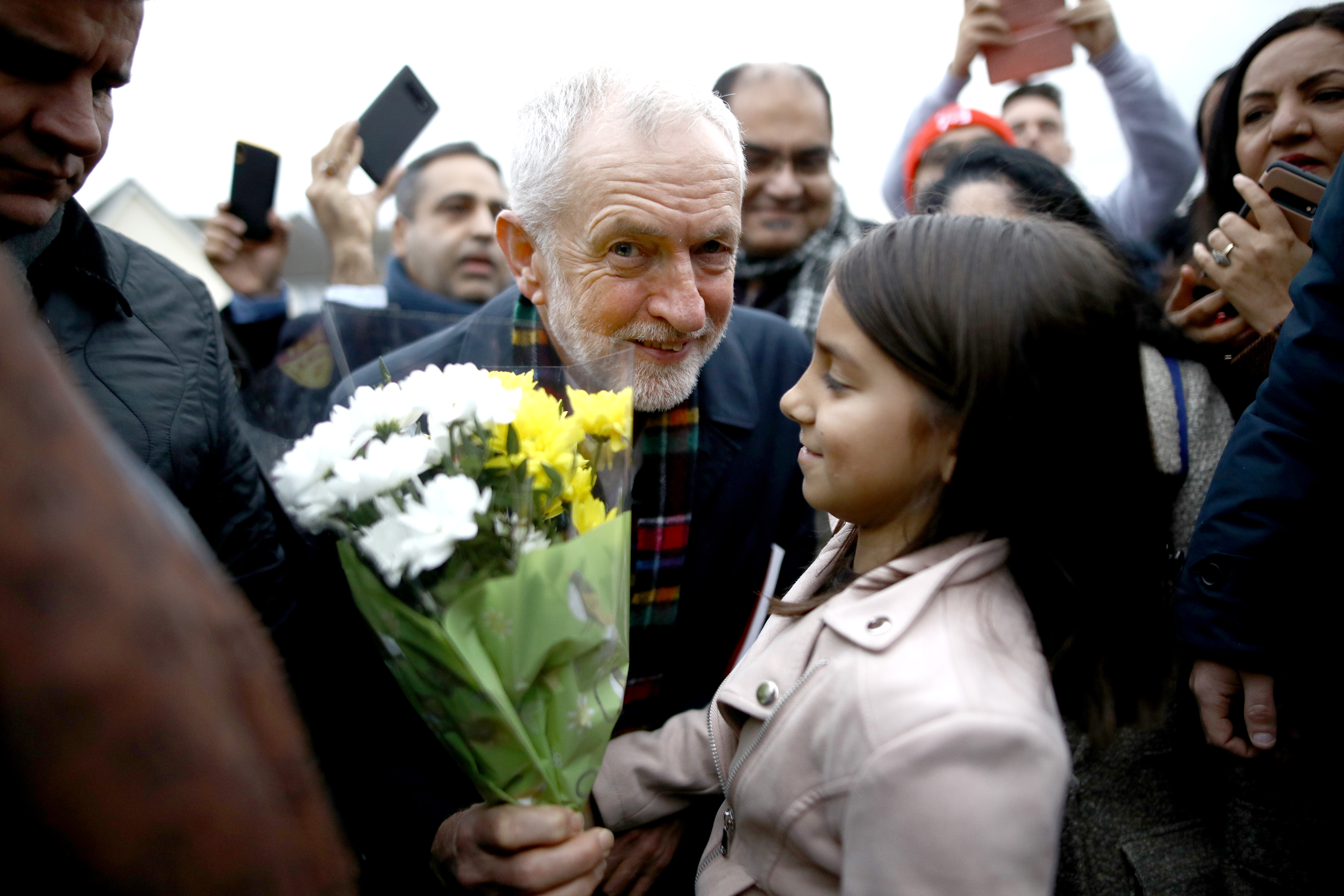 Labour Party leader Jeremy Corbyn holds some flowers as he meets supporters during a visit to Thurrock in Essex whilst on the General Election campaign trail.