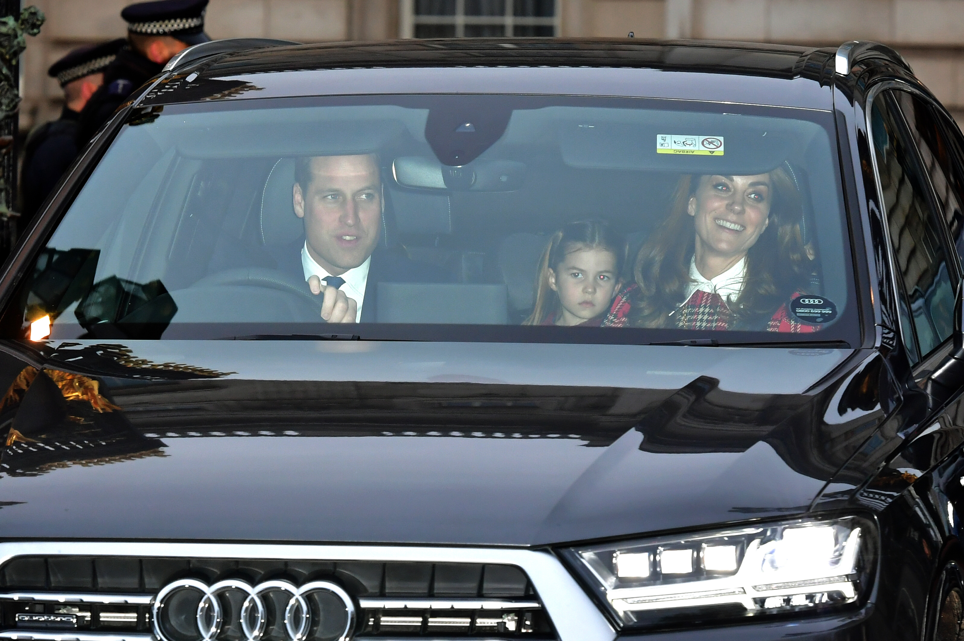 The Duke and Duchess of Cambridge with Princess Charlotte, leaving after the Queen's Christmas lunch at Buckingham Palace, London.